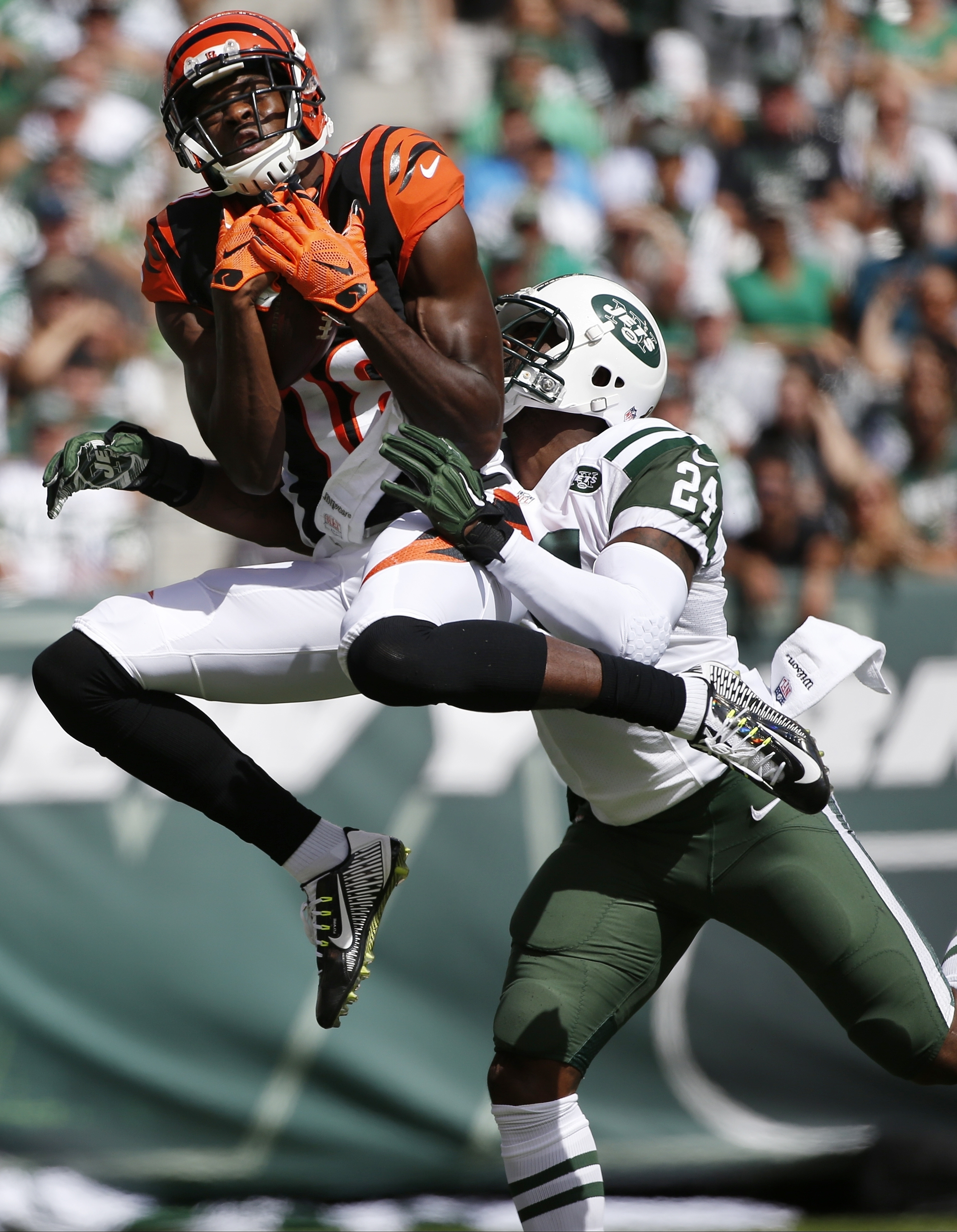FILE - In this Sunday, Sept. 11, 2016, file photo, Cincinnati Bengals' A.J. Green (18) catches a pass in front of New York Jets' Darrelle Revis (24) during the first half of an NFL football game in East Rutherford, N.J. Green has had a couple of huge game