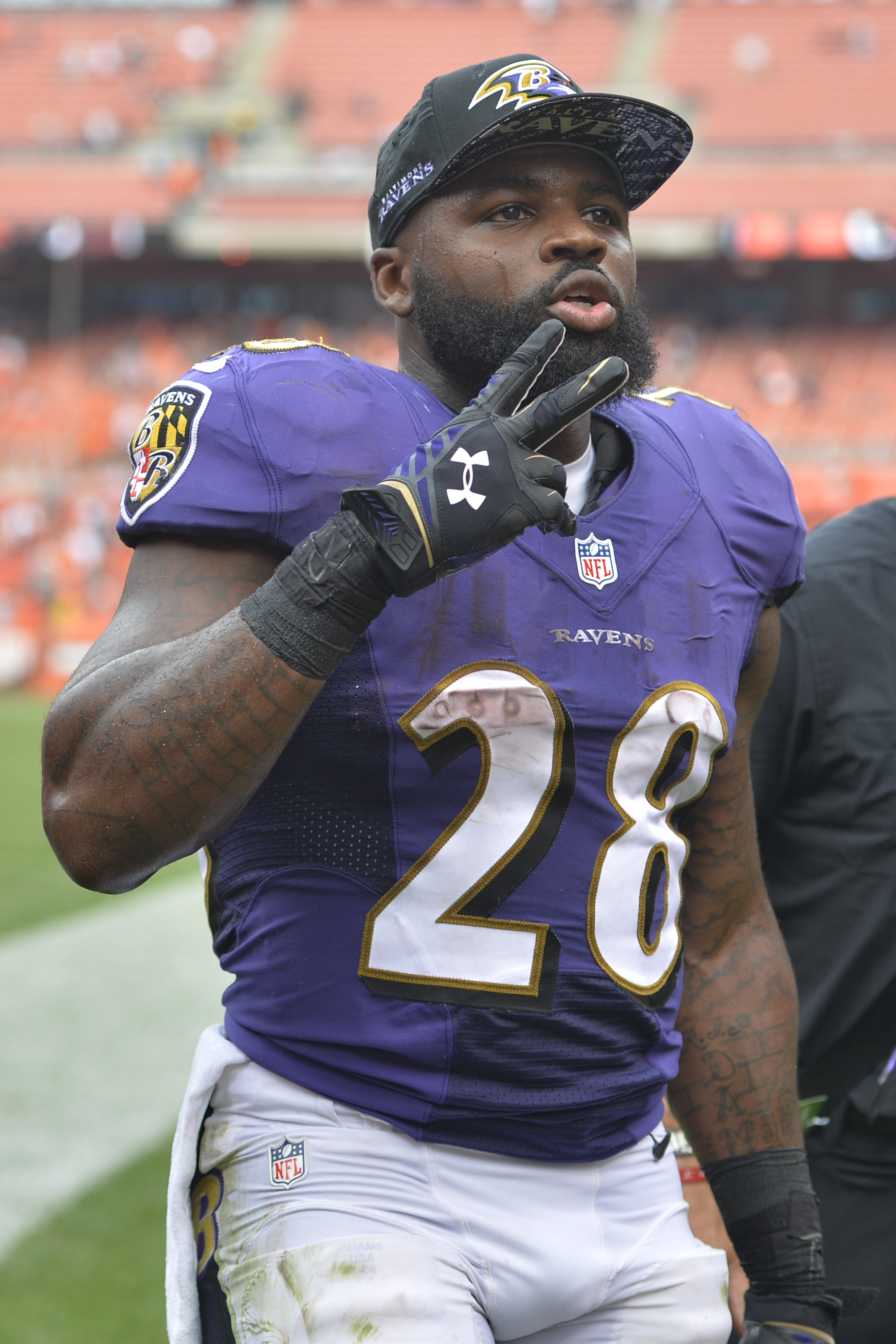 FILE - In this Sept. 18, 2016, file photo, Baltimore Ravens running back Terrance West walks off the field after a 25-20 win over the Cleveland Browns, in an NFL football game in Cleveland. West wanted the brunt of the workload carrying the ball for the B