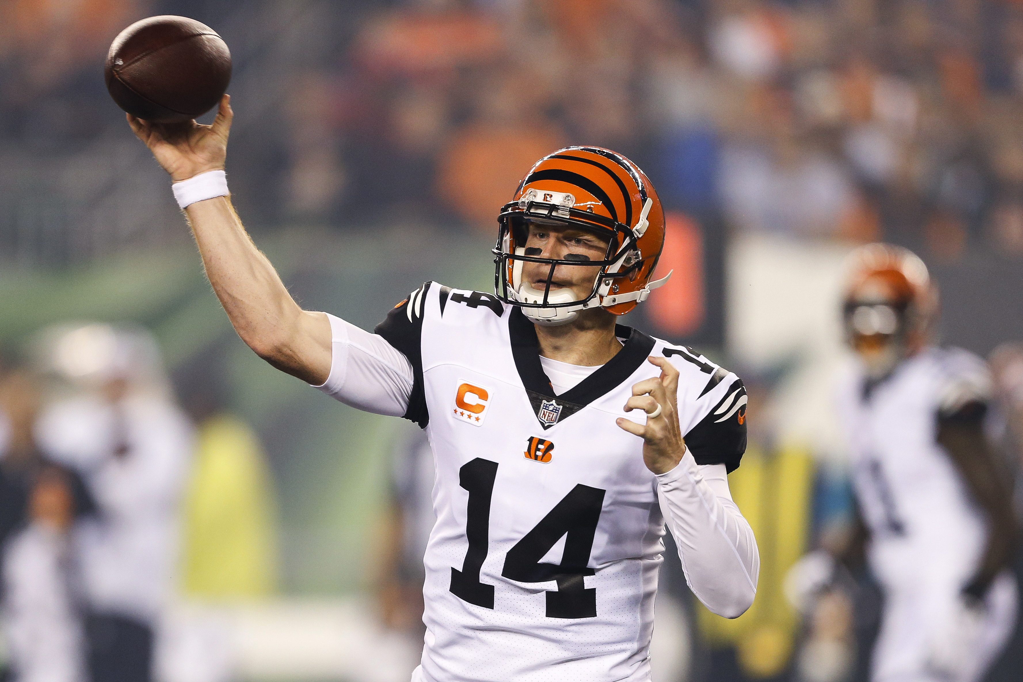 FILE - In this Thursday, Sept. 29, 2016, file photo, Cincinnati Bengals quarterback Andy Dalton throws during the first half of an NFL football game against the Miami Dolphins in Cincinnati.  Dalton is providing a suitable encore to his breakthrough seaso