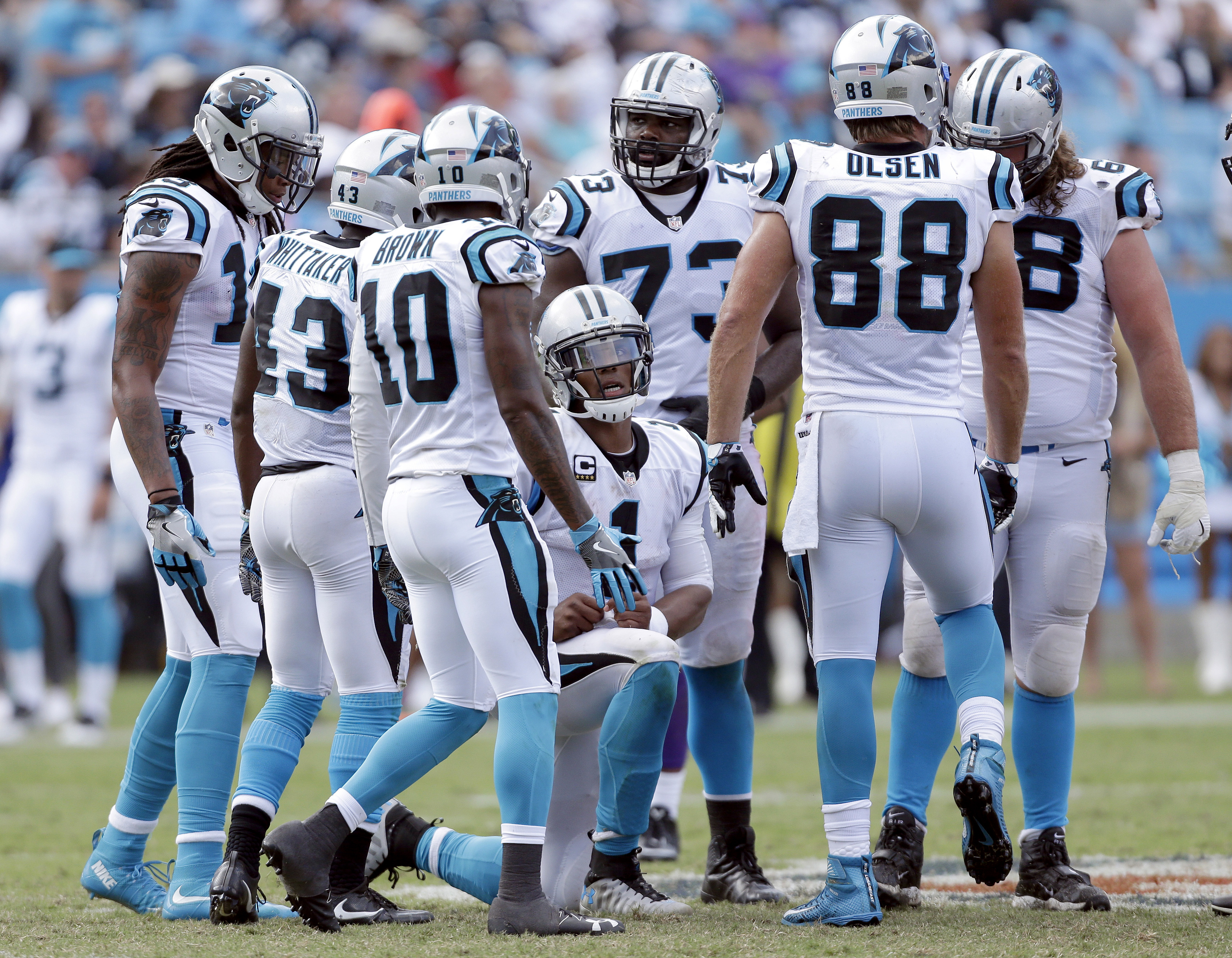 ADVANCE FOR WEEKEND EDITIONS, OCT. 8-9- FILE - In this Sunday, Sept. 18, 2016, file photo, Carolina Panthers' Cam Newton (1) kneels in the huddle as he tries to find a way to score against the Minnesota Vikings during the second half of an NFL football ga