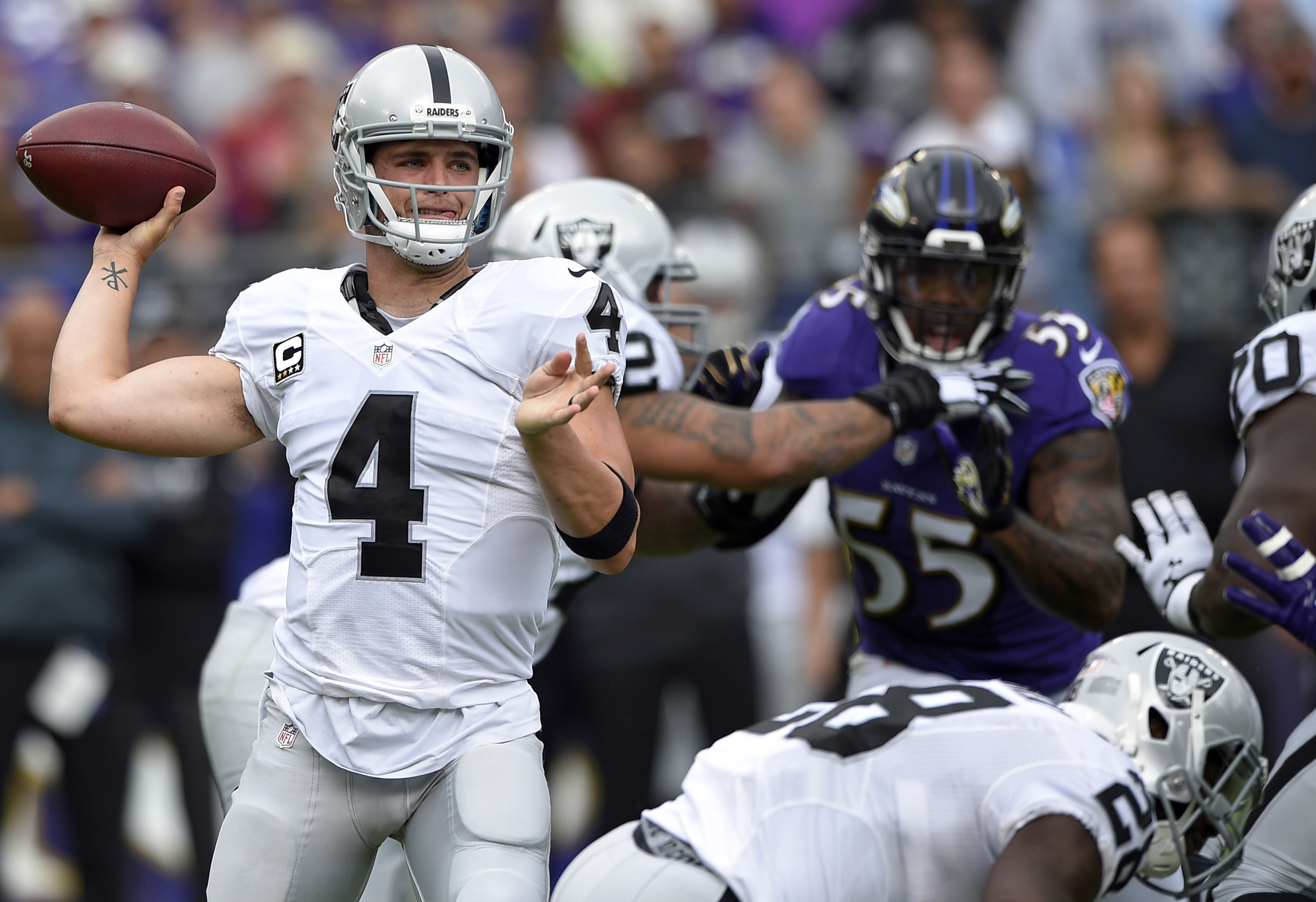 FILE - In this Sunday, Oct. 2, 2016, file photo, Oakland Raiders quarterback Derek Carr (4) throws to a receiver in the first half of an NFL football game against the Baltimore Ravens in Baltimore. The Raiders play the San Diego Chargers on Sunday. (AP Ph