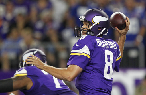 FILE - In this Oct. 3, 2016, file photo, Minnesota Vikings quarterback Sam Bradford throws a pass during the first half of an NFL football game against the New York Giants, in Minneapolis.  The Houston Texans and Vikings are among the teams with the top r