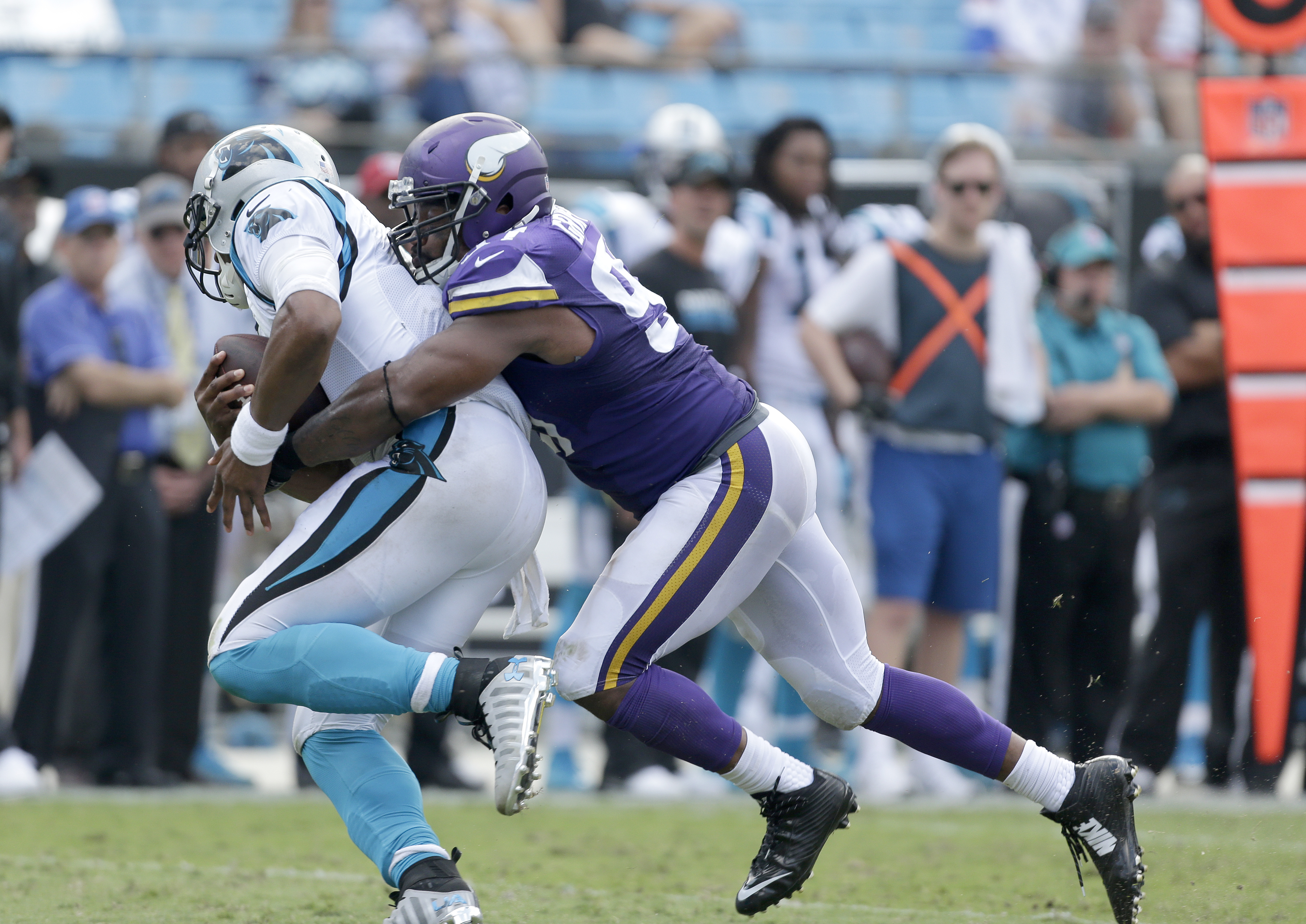 FILE - In this Sept. 18, 2016, file photo, Carolina Panthers' Cam Newton (1) can't get out of a sack by Minnesota Vikings' Everson Griffen (97) during the second half of an NFL football game in Charlotte, N.C.  The Houston Texans and Minnesota Vikings are