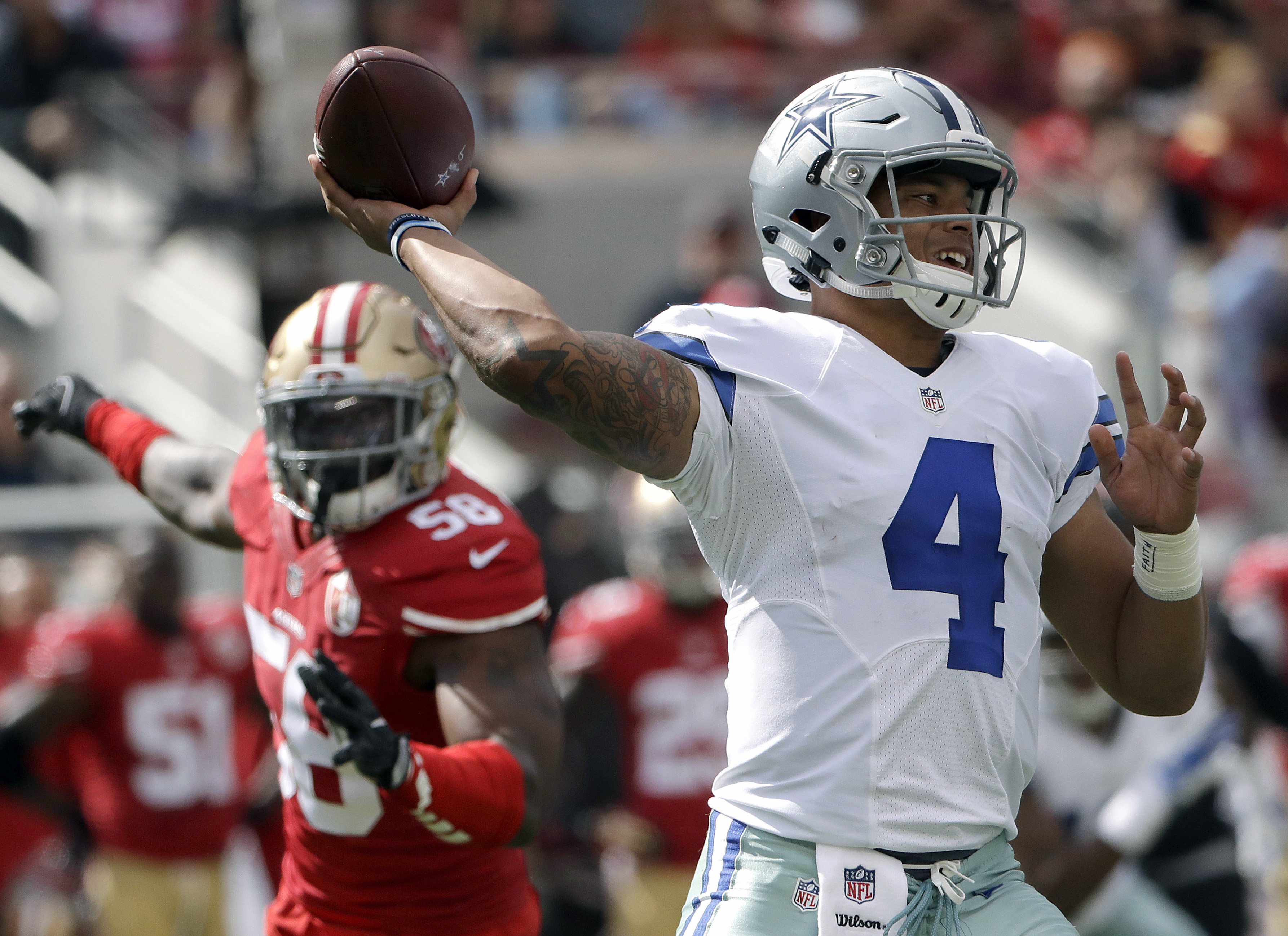 FILE - In this Oct. 2, 2016, file photo, Dallas Cowboys quarterback Dak Prescott (4) passes against the San Francisco 49ers during the first half of an NFL football game in Santa Clara, Calif. The still-perfect Prescott, with a rookie-record 131 passes wi