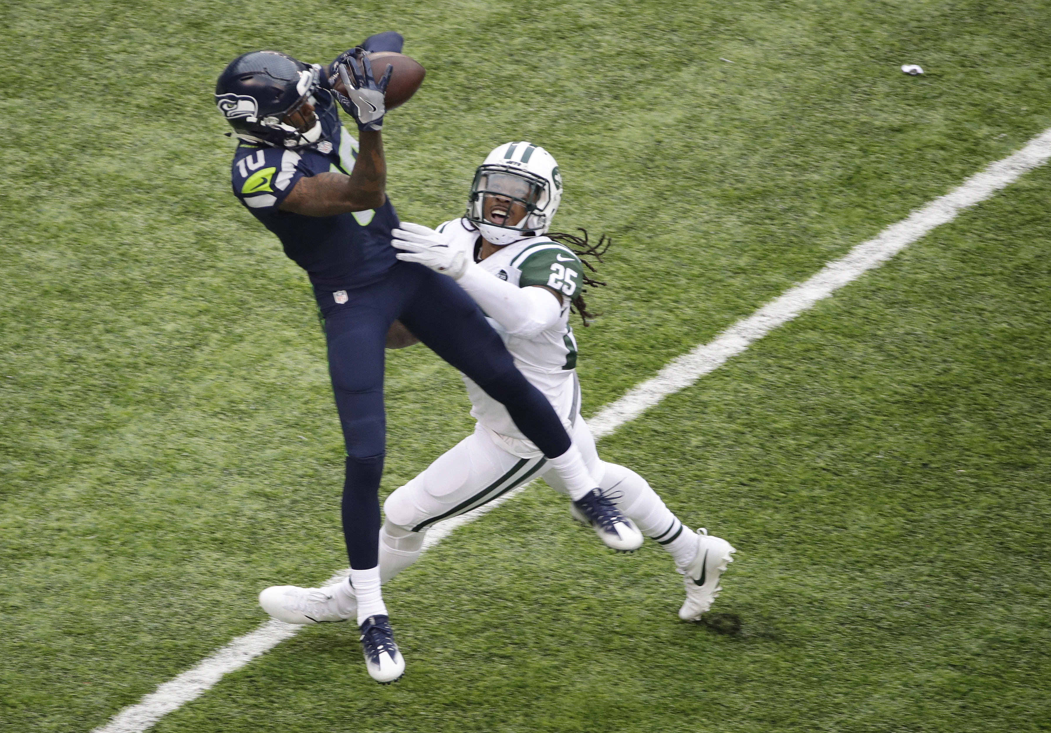 """FILE - In this Oct. 2, 2016, file photo, Seattle Seahawks wide receiver Paul Richardson catches a pass in front of New York Jets' Calvin Pryor (25) during an NFL football game in East Rutherford, N.J.  """"There's a target on our backs in the secondary,"""" Pry"""