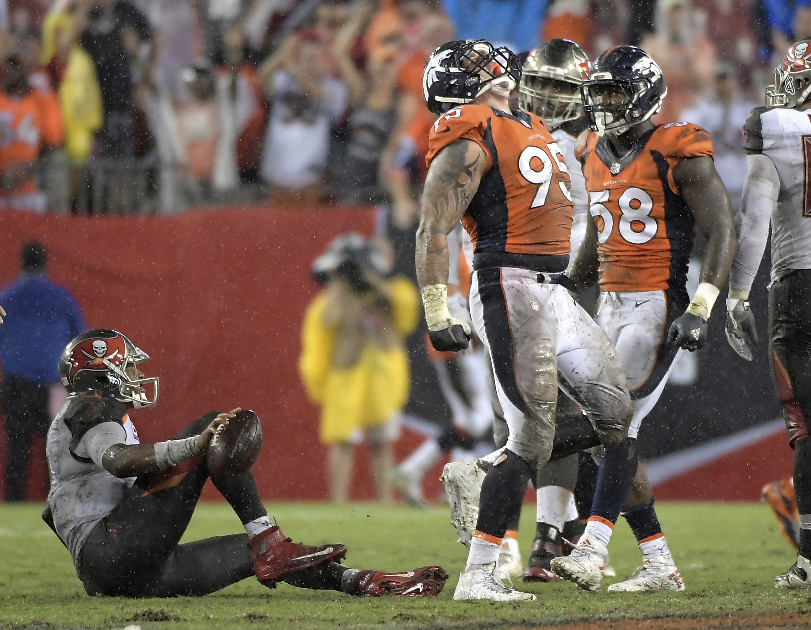 FILE - In this Oct. 2, 2016, file photo, Denver Broncos defensive end Derek Wolfe (95) celebrates after sacking Tampa Bay Buccaneers quarterback Jameis Winston, left, during an NFL football game in Tampa, Fla. Wolfe is the unsung member of Denver's dazzli