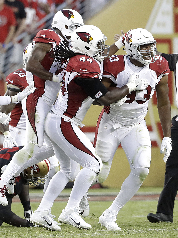 Arizona Cardinals defensive end Calais Campbell (93) celebrates after intercepting a pass against the San Francisco 49ers during the first half of an NFL football game in Santa Clara, Calif., Thursday, Oct. 6, 2016. (AP Photo/Marcio Jose Sanchez)
