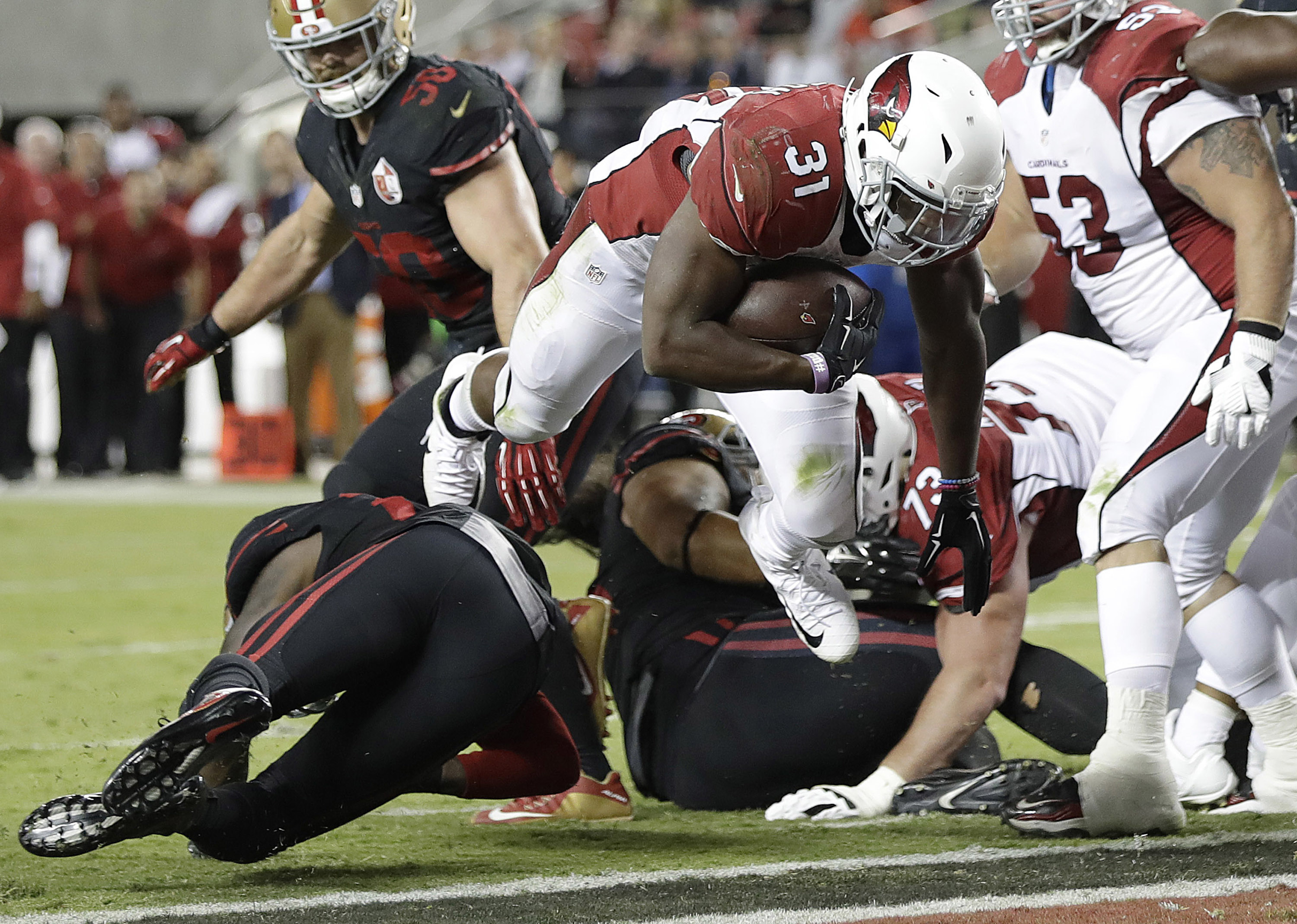 Arizona Cardinals running back David Johnson (31) scores a touchdown against the San Francisco 49ers during the second half of an NFL football game in Santa Clara, Calif., Thursday, Oct. 6, 2016. (AP Photo/Marcio Jose Sanchez)