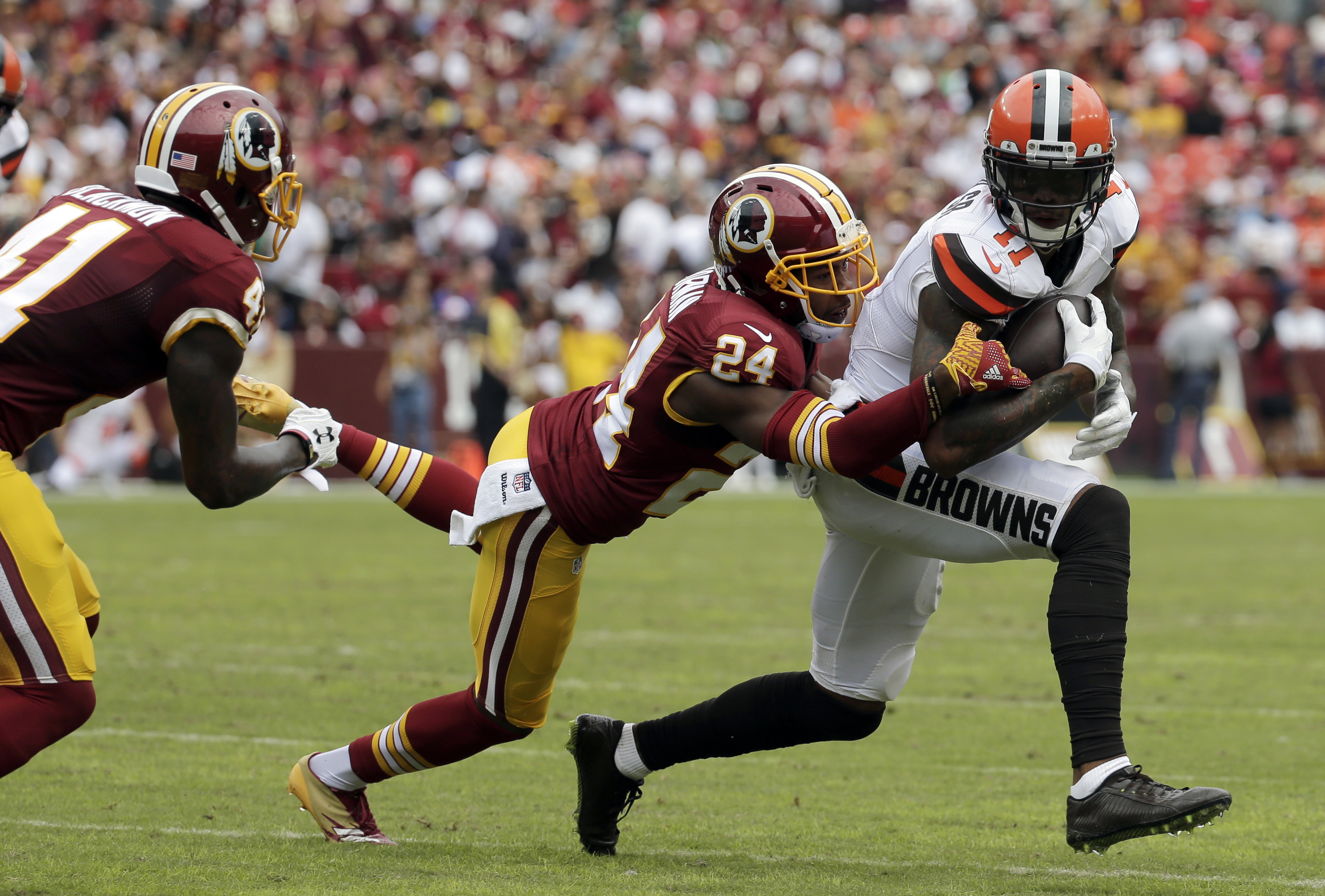 FILE - In this Oct. 2, 2016, file photo, Cleveland Browns wide receiver Terrelle Pryor (11) is tackled by Washington Redskins cornerback Josh Norman (24) during the first half of an NFL football game in Landover, Md. Its difficult to imagine where the Red