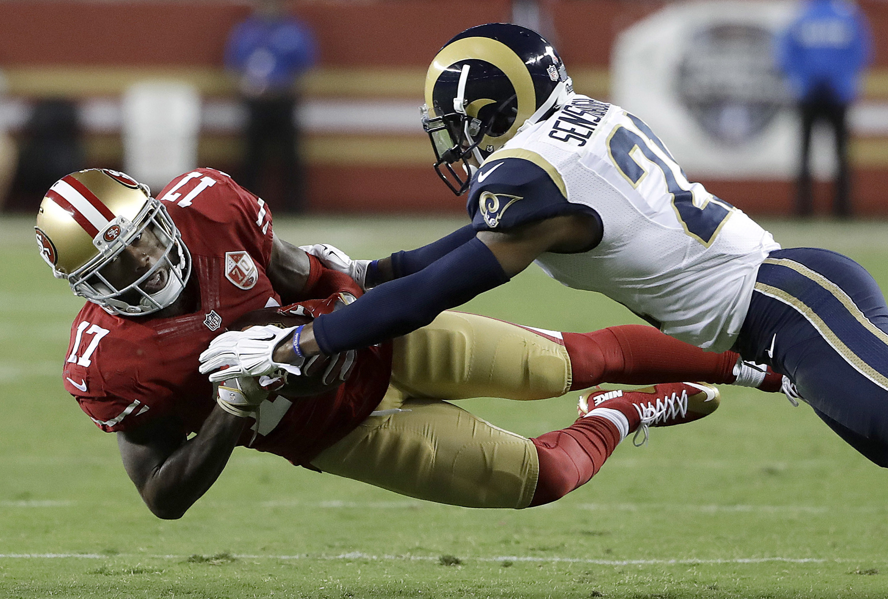 San Francisco 49ers wide receiver Jeremy Kerley (17) catches a pass in front of Los Angeles Rams defensive back Coty Sensabaugh during the first half of an NFL football game in Santa Clara, Calif., Monday, Sept. 12, 2016. (AP Photo/Marcio Jose Sanchez)