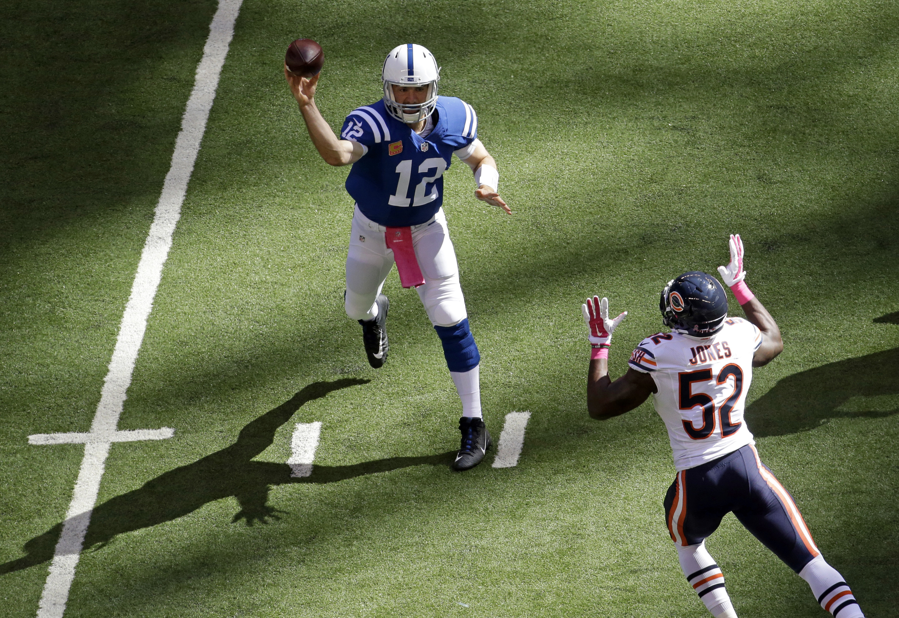 Indianapolis Colts quarterback Andrew Luck (12) throws over Chicago Bears inside linebacker Christian Jones (52) during the first half of an NFL football game in Indianapolis, Sunday, Oct. 9, 2016. (AP Photo/AJ Mast)