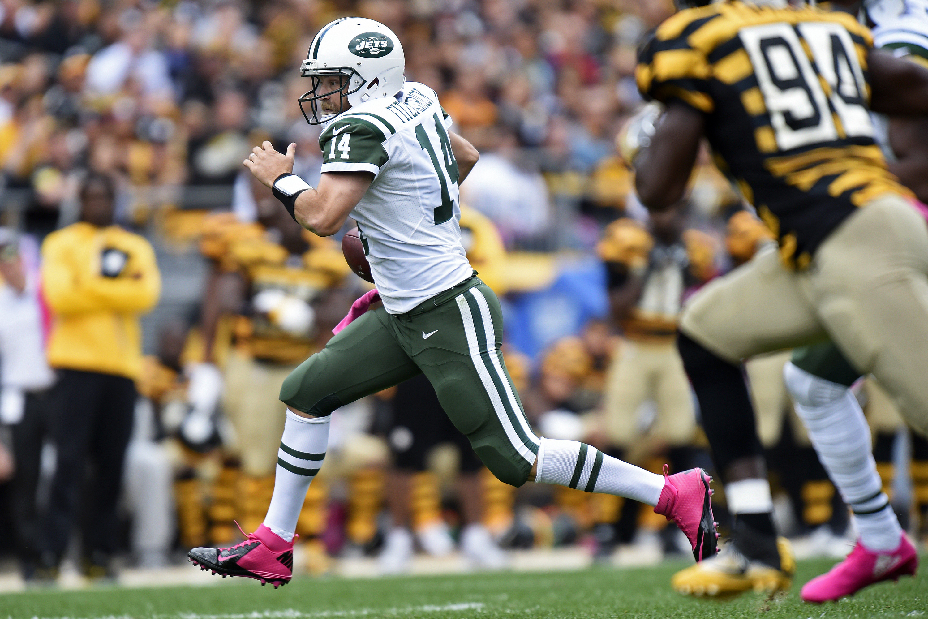 New York Jets quarterback Ryan Fitzpatrick (14) runs with the ball during the first half of an NFL football game against the Pittsburgh Steelers in Pittsburgh, Sunday, Oct. 9, 2016. (AP Photo/Don Wright)