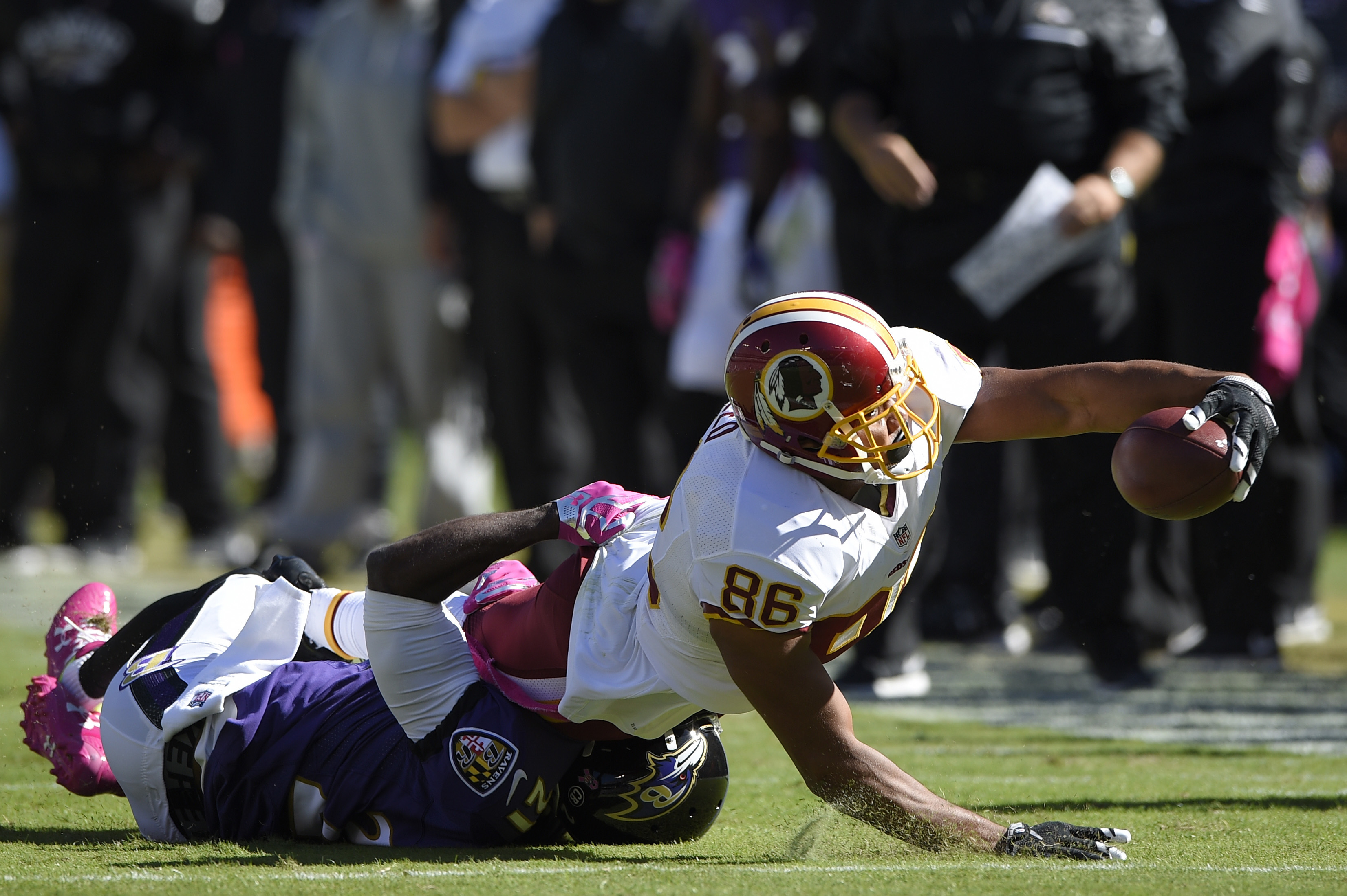Washington Redskins' Jordan Reed (86) reaches for extra yardage as Baltimore Ravens' Lardarius Webb (21) tackles him during the first half of an NFL football game, Sunday, Oct. 9, 2016, in Baltimore. (AP Photo/Nick Wass)