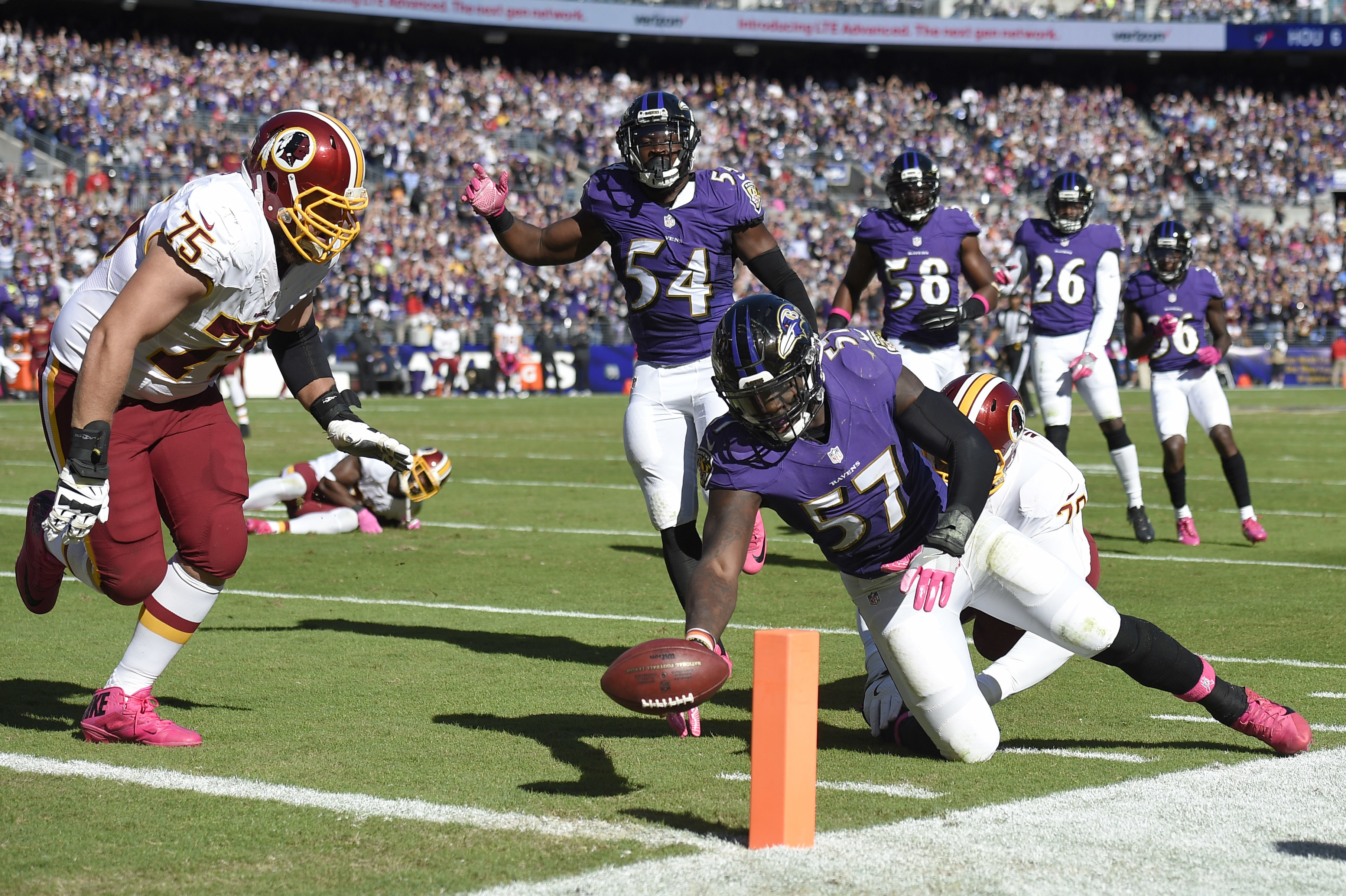 Baltimore Ravens' C.J. Mosley (57) fumbles a pass he interceptedduring the second half of an NFL football game against the Washington Redskins, Sunday, Oct. 9, 2016, in Baltimore. (AP Photo/Nick Wass)