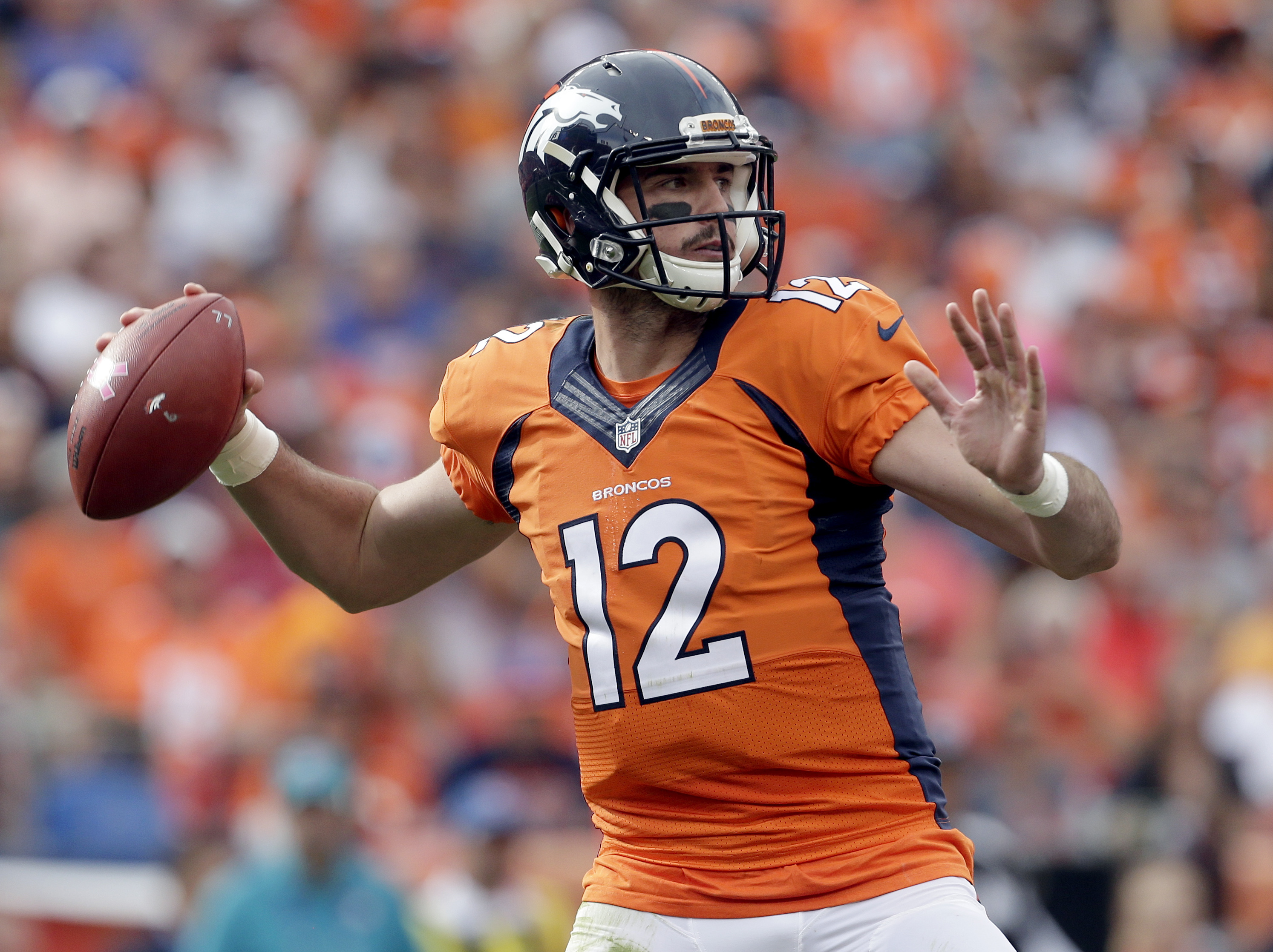 Denver Broncos quarterback Paxton Lynch (12) throws against the Atlanta Falcons during the first half of an NFL football game, Sunday, Oct. 9, 2016, in Denver. (AP Photo/Joe Mahoney)