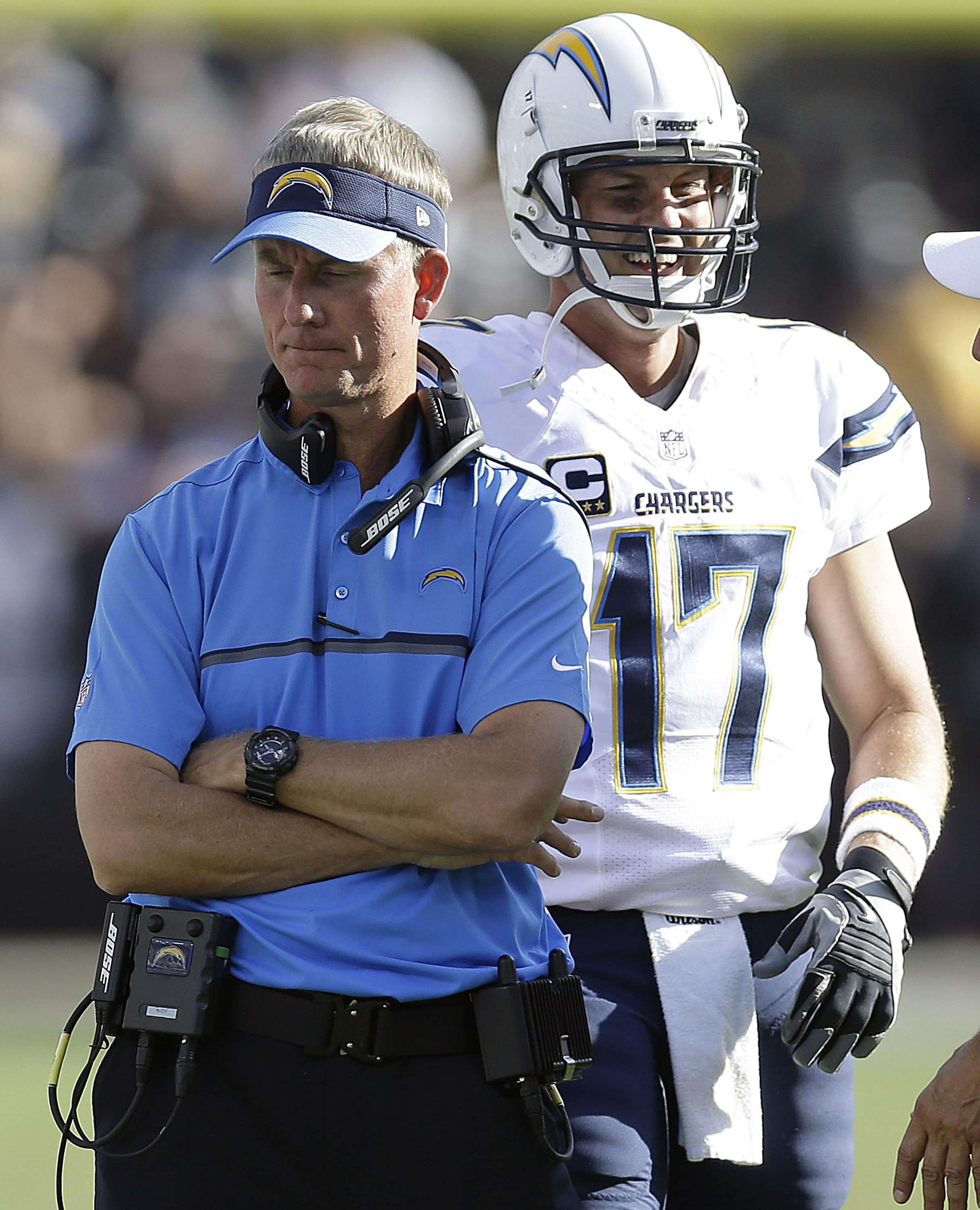 San Diego Chargers head coach Mike McCoy, left, stands in front of quarterback Philip Rivers (17) during the second half of an NFL football game against the Oakland Raiders in Oakland, Calif., Sunday, Oct. 9, 2016. (AP Photo/Ben Margot)