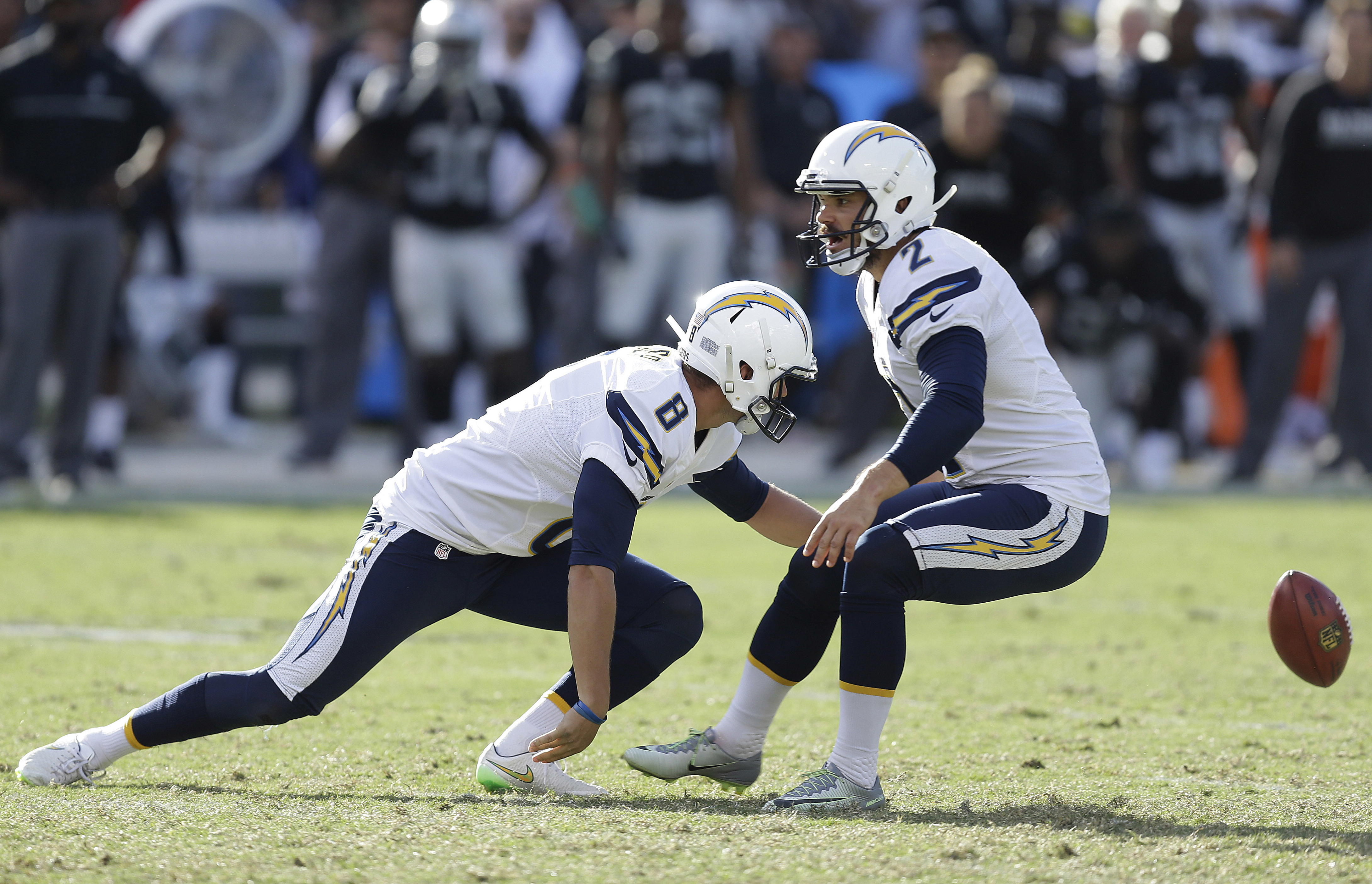 San Diego Chargers punter Drew Kaser, left, tries to retrieve the ball on a field goal attempt next to kicker Josh Lambo (2) during the second half of an NFL football game against the Oakland Raiders in Oakland, Calif., Sunday, Oct. 9, 2016. (AP Photo/Ben