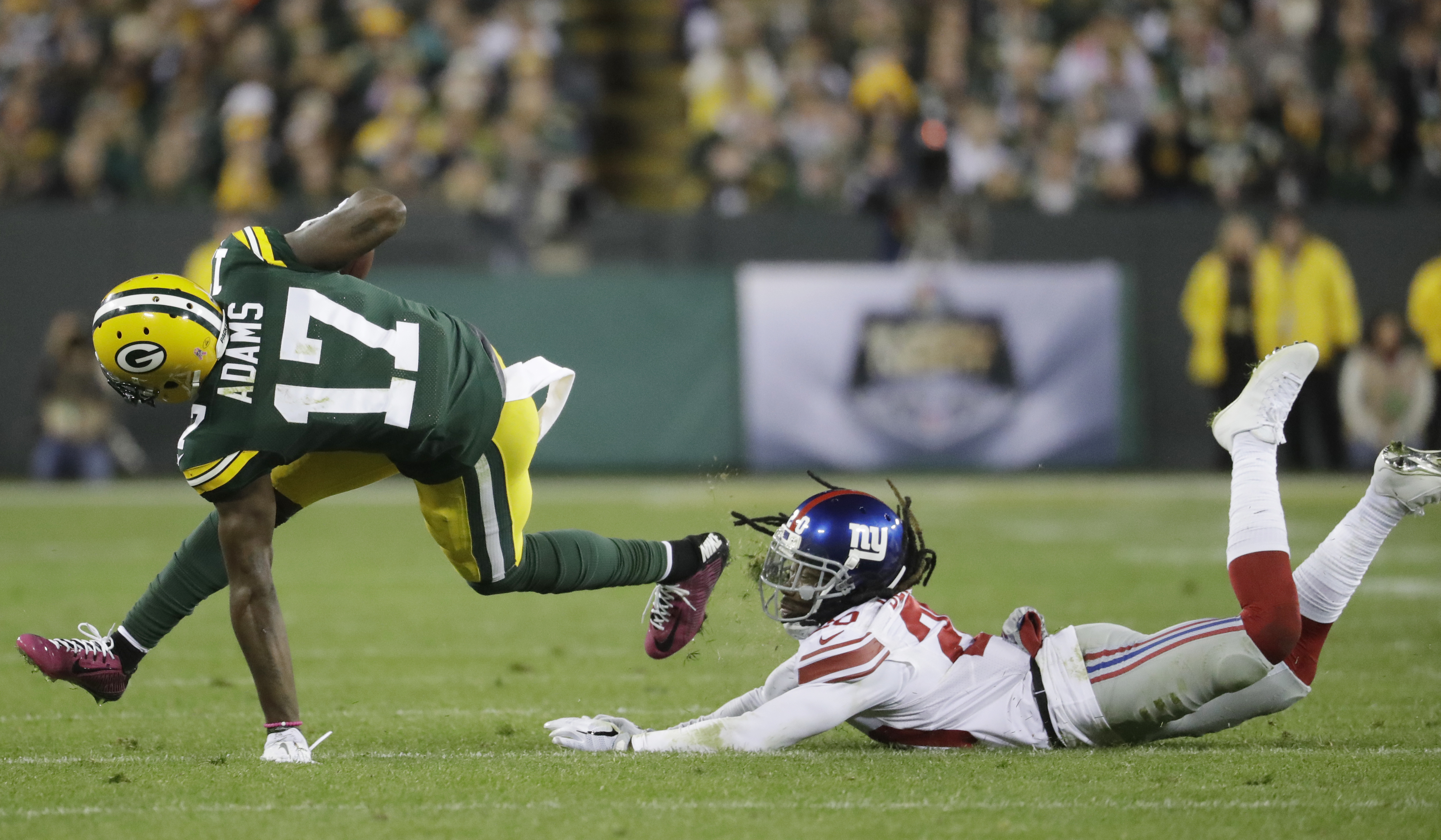 Green Bay Packers' Davante Adams gets past New York Giants' Janoris Jenkins after catching a pass during the second half of an NFL football game Sunday, Oct. 9, 2016, in Green Bay, Wis. (AP Photo/Morry Gash)