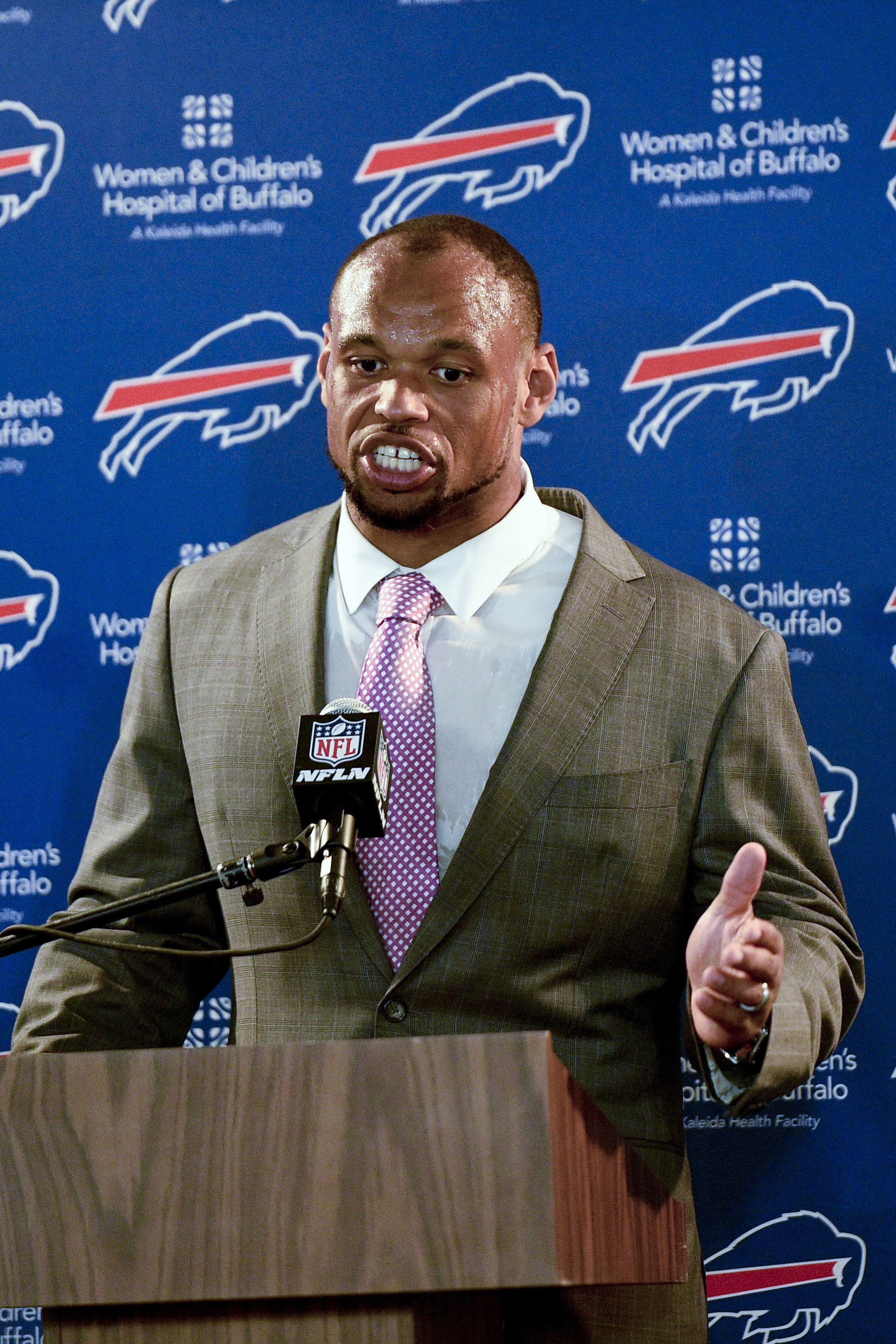 This Oct. 9, 2016 photo shows Buffalo Bills outside linebacker Lorenzo Alexander speaking at a news conference in Los Angeles.  Alexander has helped the Buffalo Bills defense re-establish its pass-rushing identity. Five weeks into the season, the 10-year