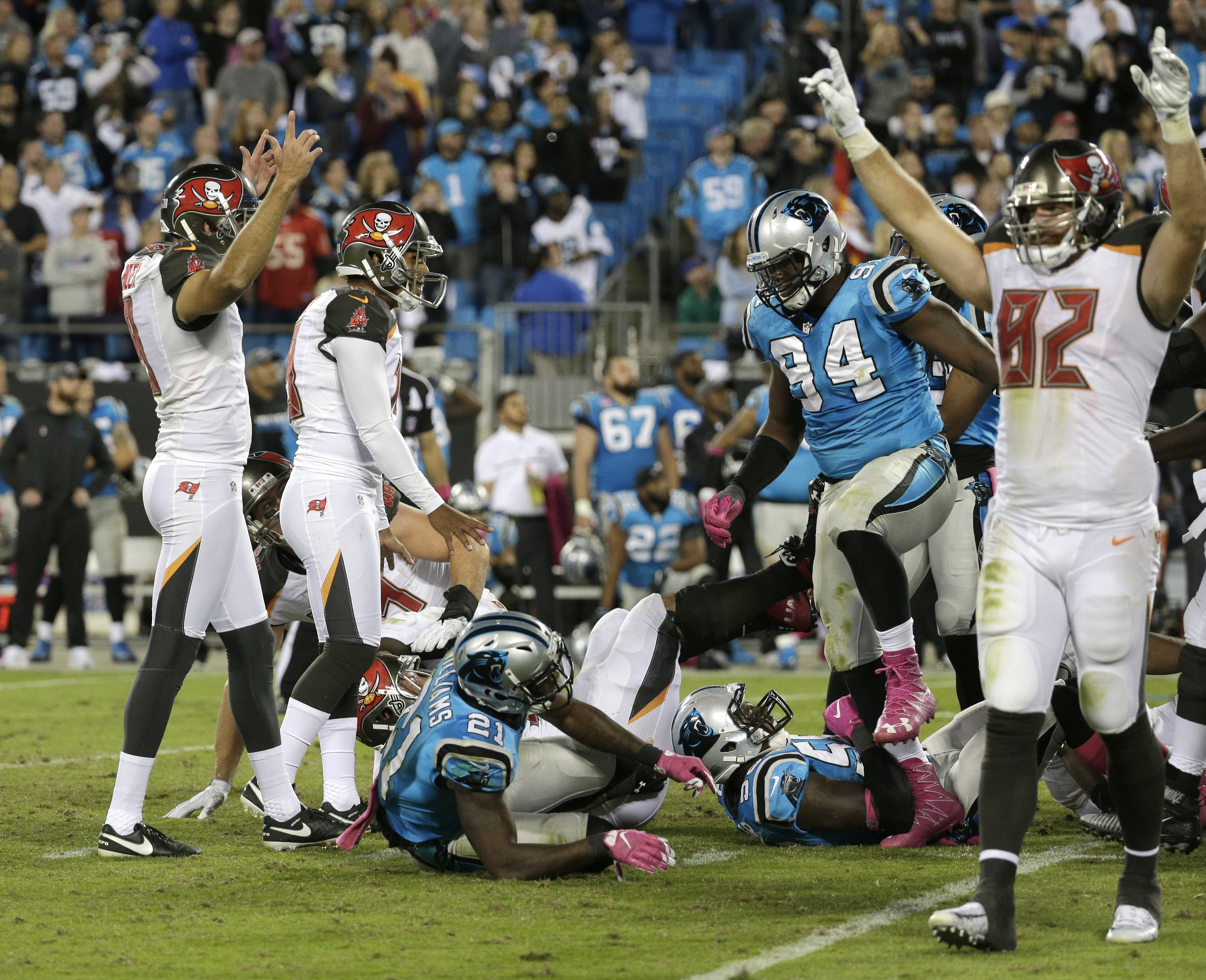 Tampa Bay Buccaneers players celebrate after Roberto Aguayo's game-winning kick against the Carolina Panthers in the second half of an NFL football game in Charlotte, N.C., Monday, Oct. 10, 2016. (AP Photo/Chuck Burton)