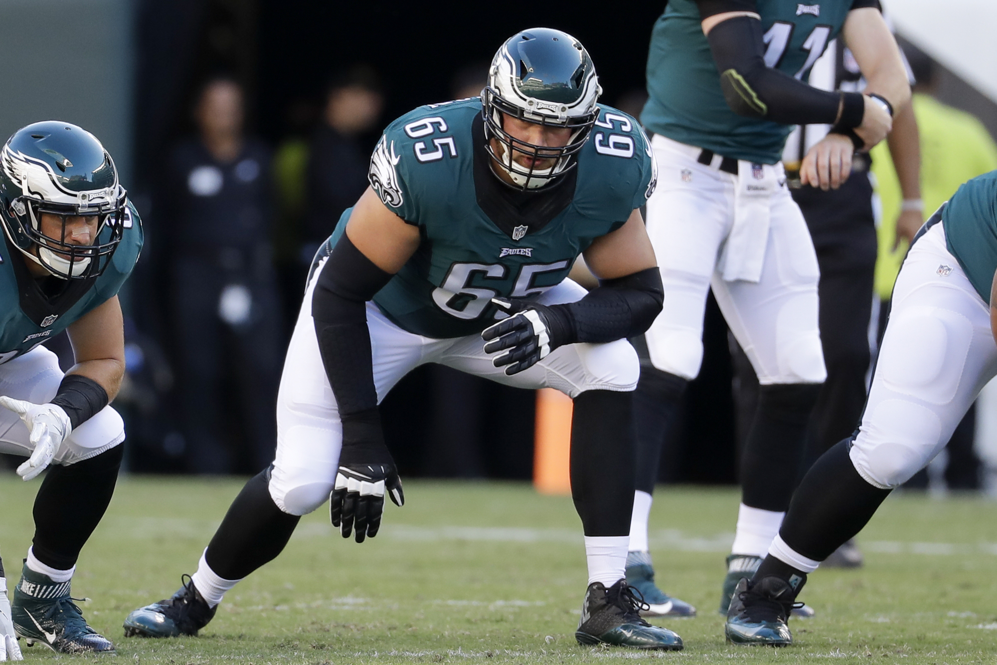 FILE - In this Sept. 25, 2016, file photo, Philadelphia Eagles tackle Lane Johnson (65) waits for a play to start during the first half of the NFL football game against the Pittsburgh Steelers, in Philadelphia. Eagles right tackle Lane Johnson has been su