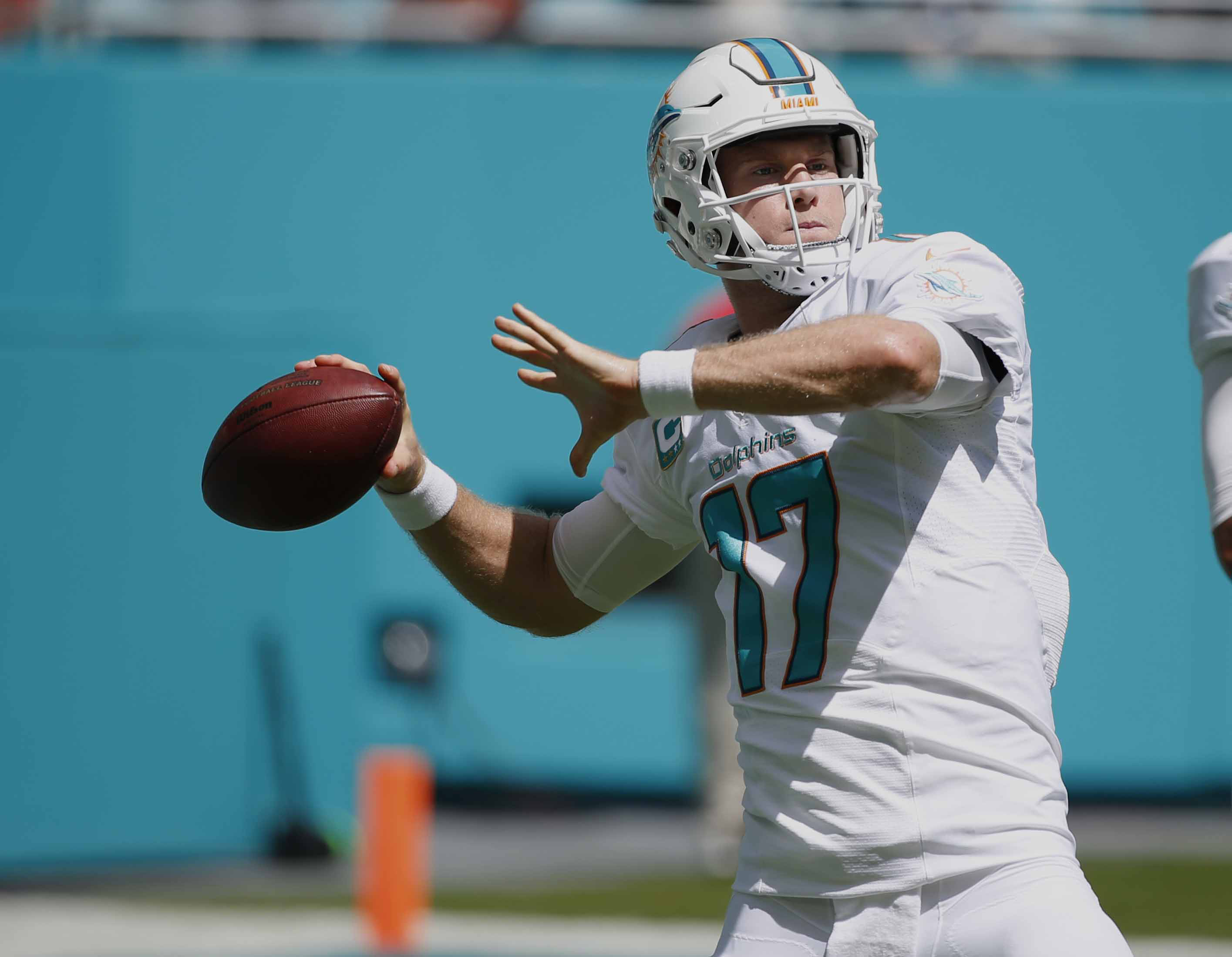 FILE - In this Sept. 25, 2016, file photo, Miami Dolphins quarterback Ryan Tannehill (17) warms up before an NFL football game against the Cleveland Browns, in Miami Gardens, Fla. Tannehill has been sacked more than 200 times since he joined the Miami Dol