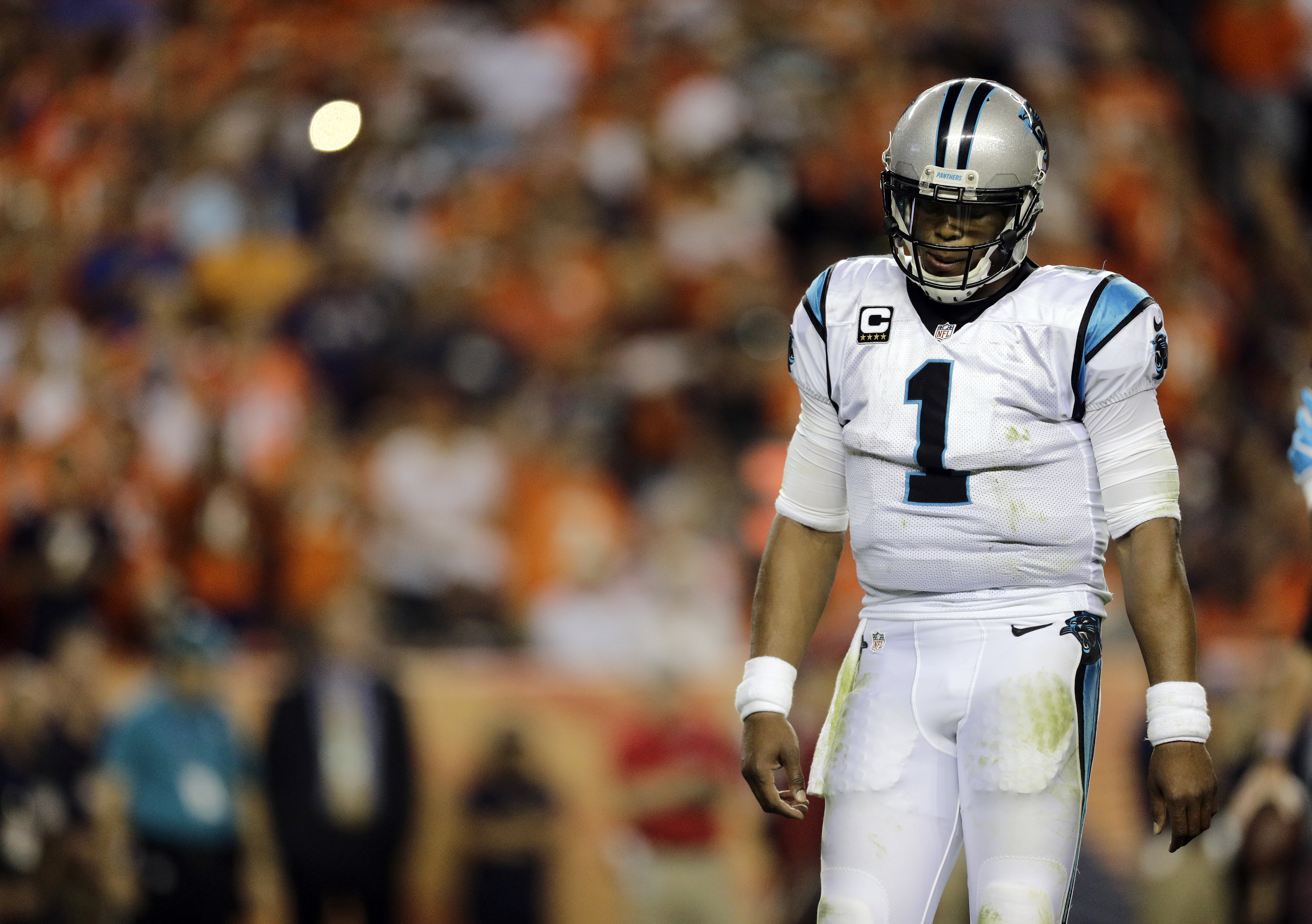 FILE - In this Sept. 8, 2016, file photo, Carolina Panthers quarterback Cam Newton (1) walks to the sidelines during the second half of an NFL football game against the Denver Broncos in Denver. The Panthers are hoping Newton can get back on the field in