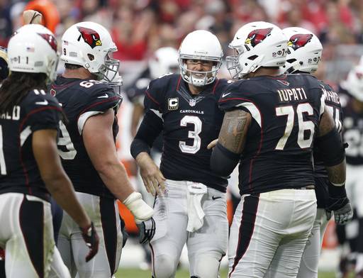 FILE - In this Sunday, Oct. 2, 2016, file photo, Arizona Cardinals quarterback Carson Palmer (3) is helped up after a getting sacked against the Los Angeles Rams during the second half of an NFL football game in Glendale, Ariz.  Cleared to practice, Palme