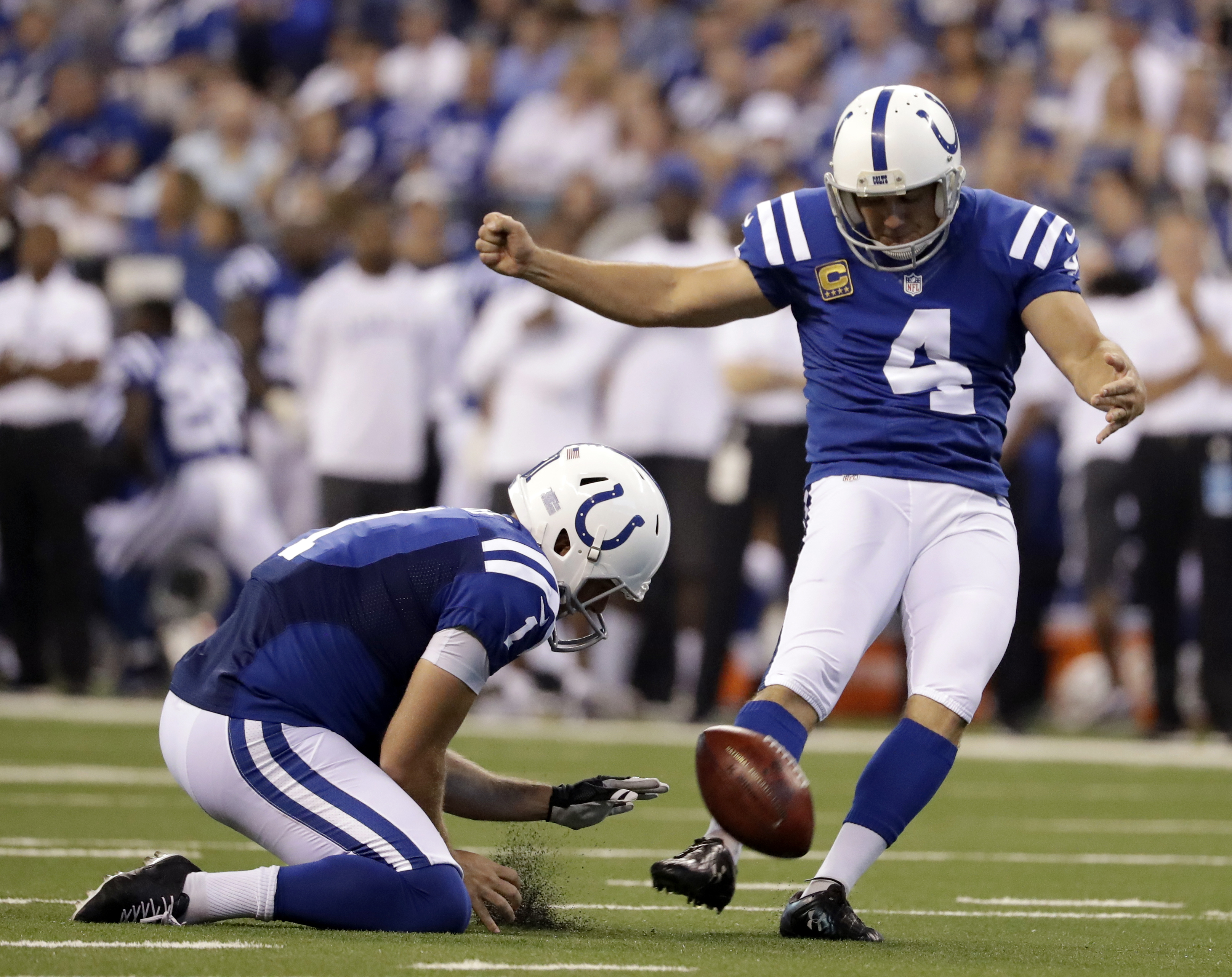 FILE - In this Sept. 25, 2016, file photo, Indianapolis Colts' Adam Vinatieri (4) kicks a 33-yard field goal out of the hold of Pat McAfee (1) during the first half of an NFL football game against the San Diego Chargers in Indianapolis. Around the Colts'
