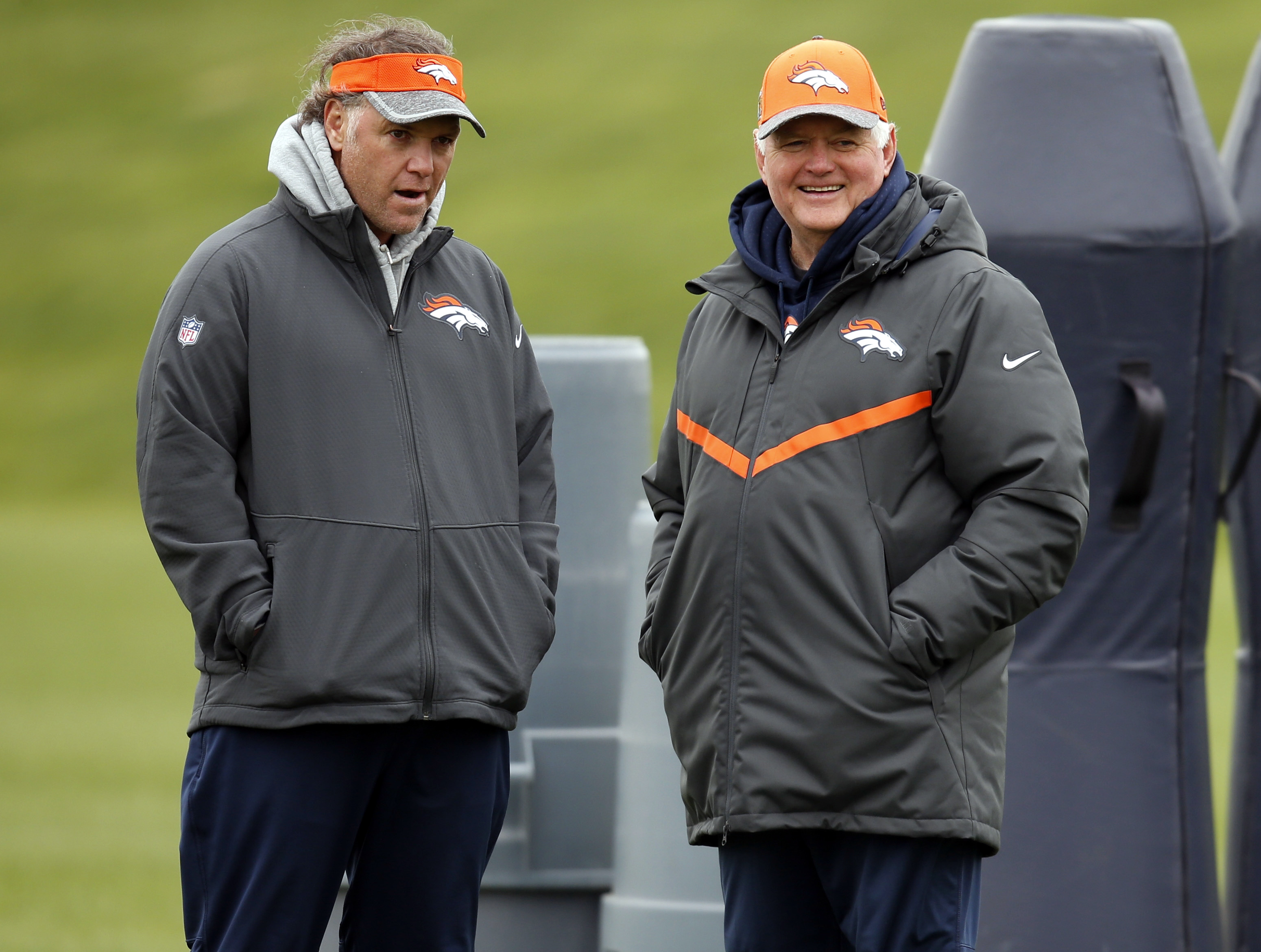 FILE - In this May 7, 2016, file photo, Denver Broncos special teams coach Joe DeCamillis, left, and defensive coordinator Wade Phillips watch during the team's NFL rookie camp football practice in Englewood, Colo. DeCamillis insists he doesn't see steppi
