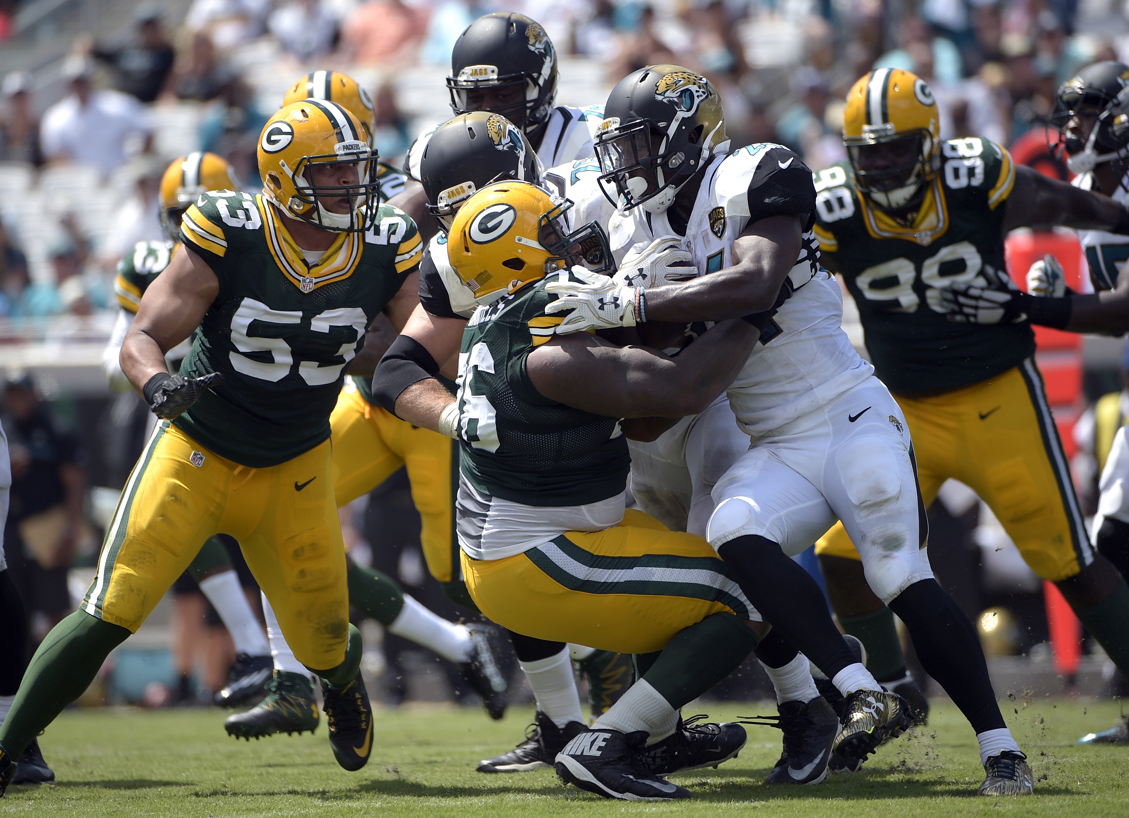 FILE - In tis Sept. 11, 2016, file photo, Jacksonville Jaguars running back T.J. Yeldon (24) is tackled by Green Bay Packers defensive end Mike Daniels (76) during the first half of an NFL football game in Jacksonville, Fla. The toughest test yet of the s