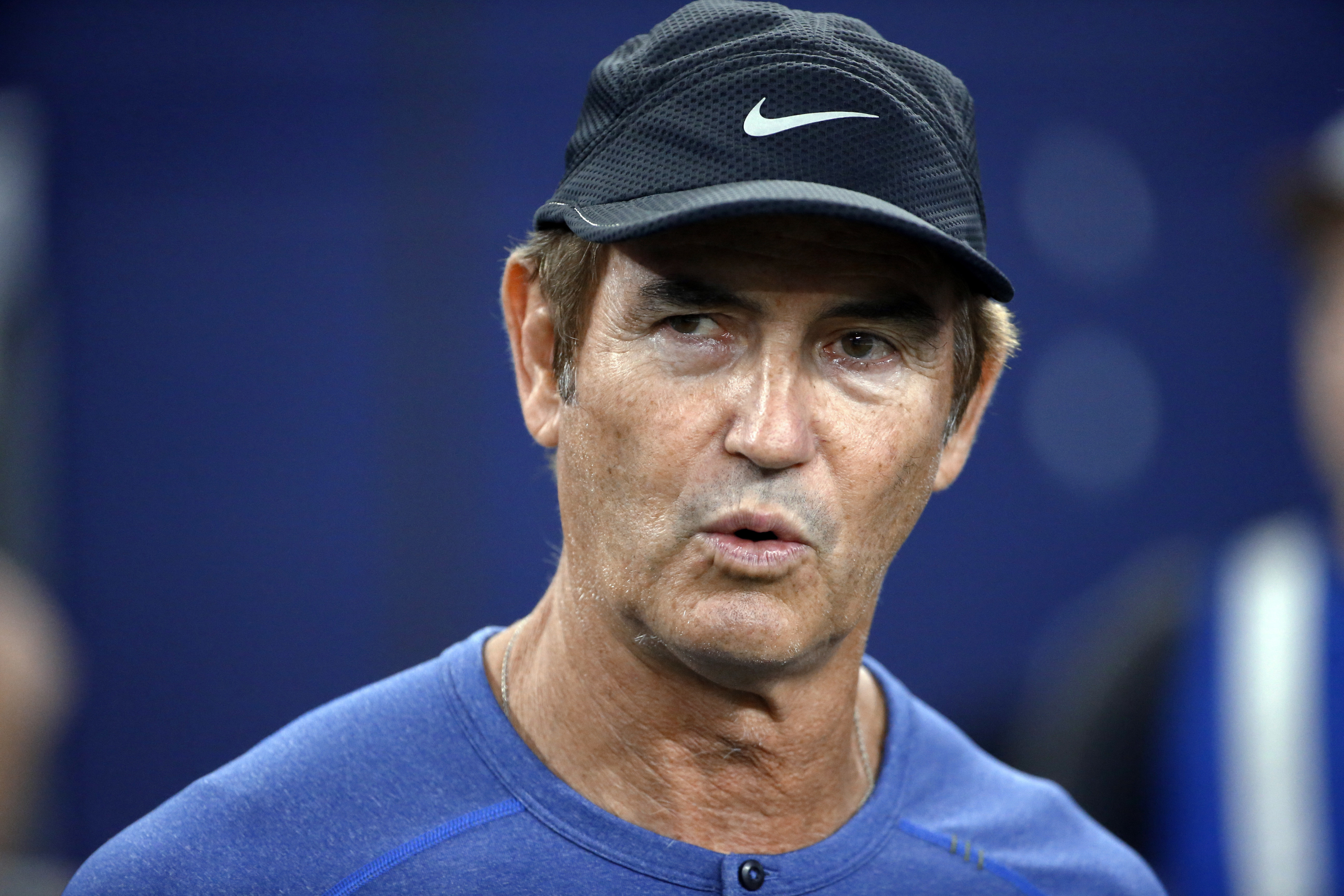 FILE - In this Sept. 25, 2016, file photo, former Baylor football coach Art Briles watches the Dallas Cowboys and the Chicago Bears warm up for an NFL football game in Arlington, Texas. Cleveland Browns coach Hue Jackson defended inviting Briles to work w