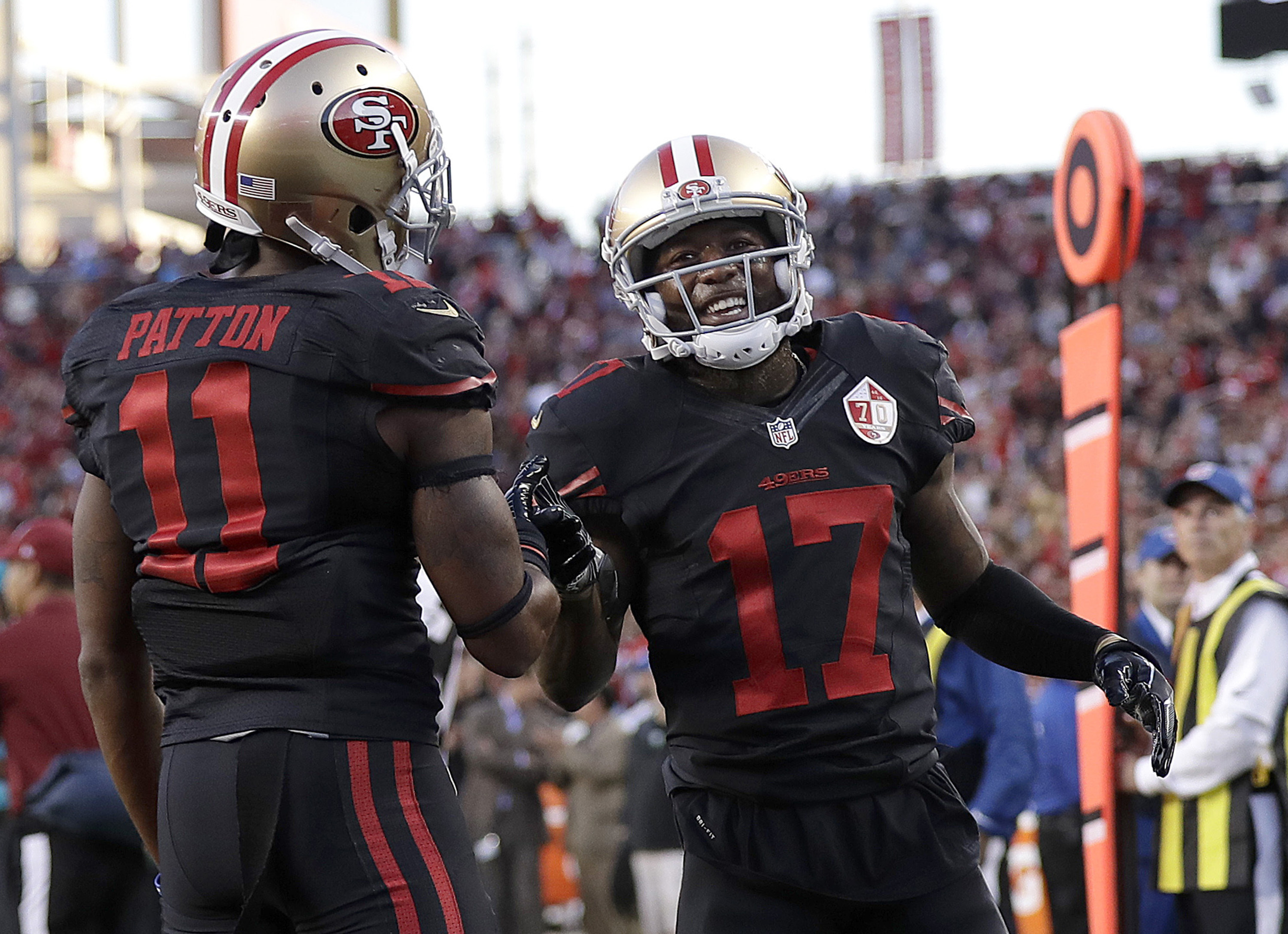 FILE - In this Oct. 6, 2016, file photo, San Francisco 49ers wide receiver Jeremy Kerley (17) is congratulated by Quinton Patton (11) after scoring on a reception during the first half of an NFL football game against the Arizona Cardinals, in Santa Clara,