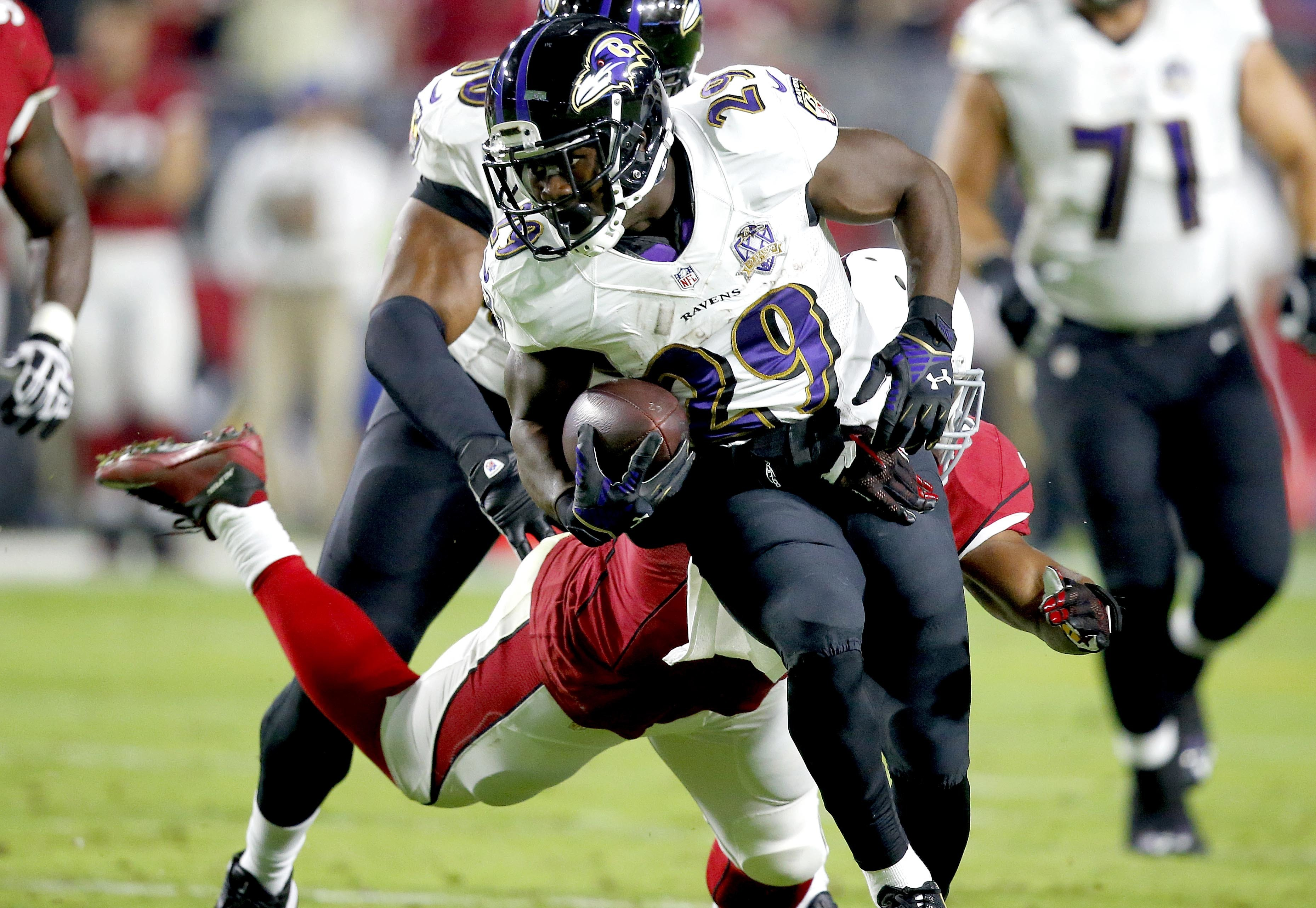 FILE - In this Oct. 26, 2015, file photo, then-Baltimore Ravens running back Justin Forsett (29) runs against the Arizona Cardinals during the first half of an NFL football game,in Glendale, Ariz. The Detroit Lions signed running back Justin Forsett earli