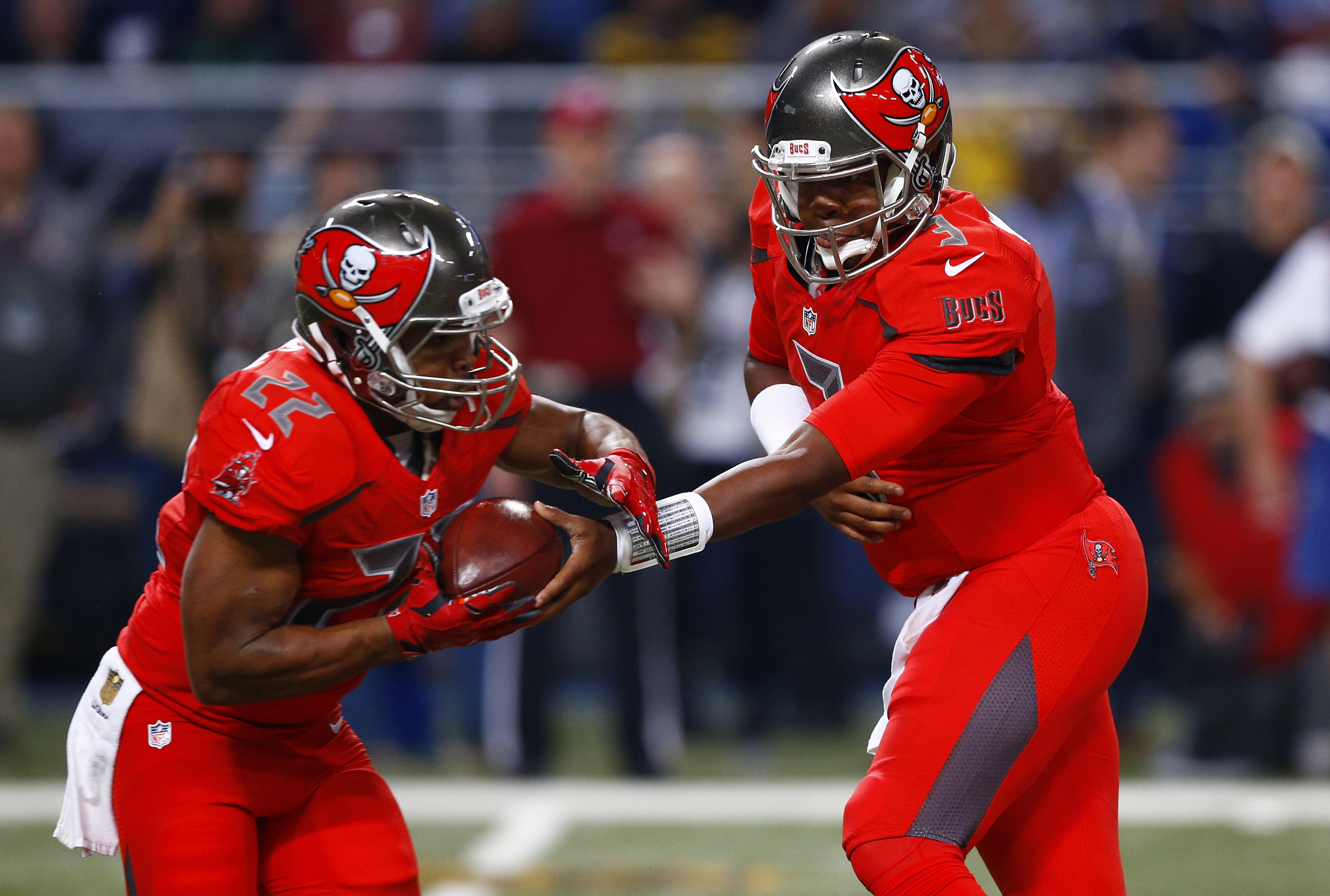 FILE - In this Dec. 17, 2015, file photo, Tampa Bay Buccaneers quarterback Jameis Winston, right, hands off to running back Doug Martin during the first quarter of an NFL football game against the St. Louis Rams in St. Louis. Winston has to play better fo