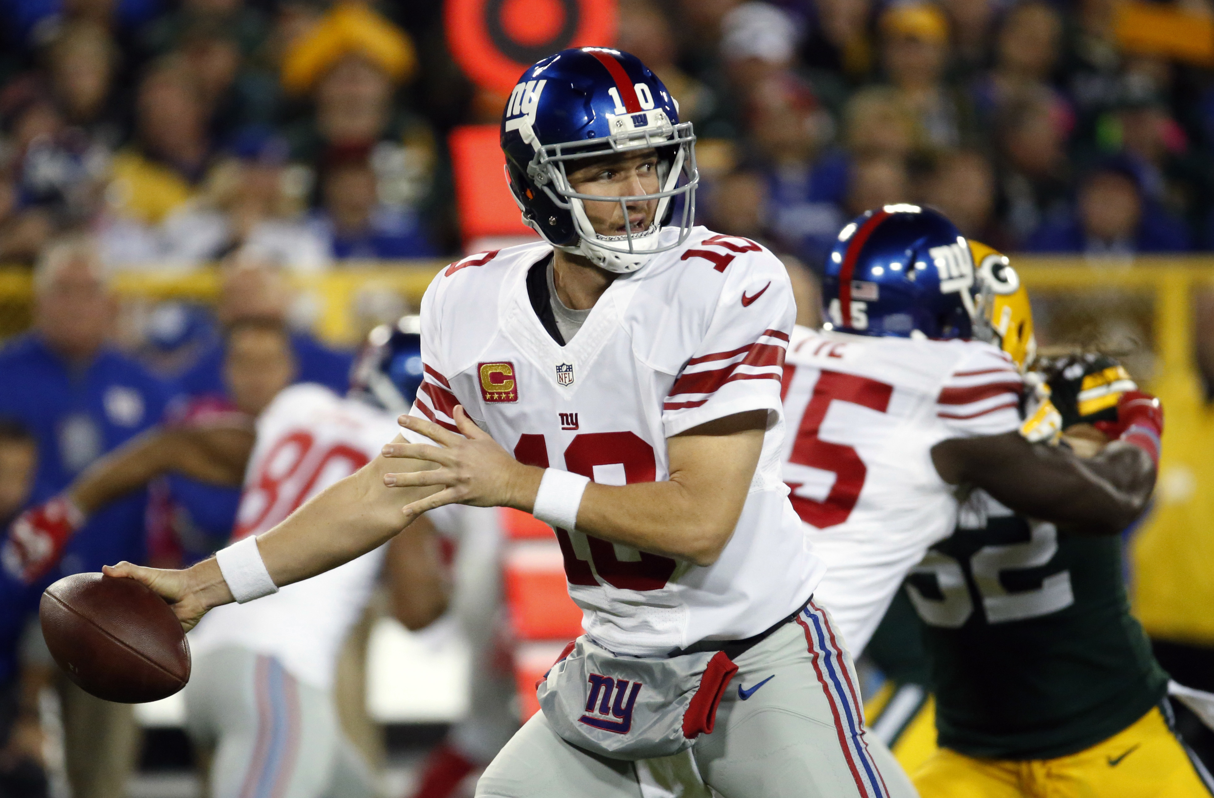 FILE - In this Oct. 9, 2016, file photo, New York Giants' Eli Manning throws during the first half of an NFL football game against the Green Bay Packers in Green Bay, Wis. Manning has not been sharp and the offensive line has been inconsistent. (AP Photo/