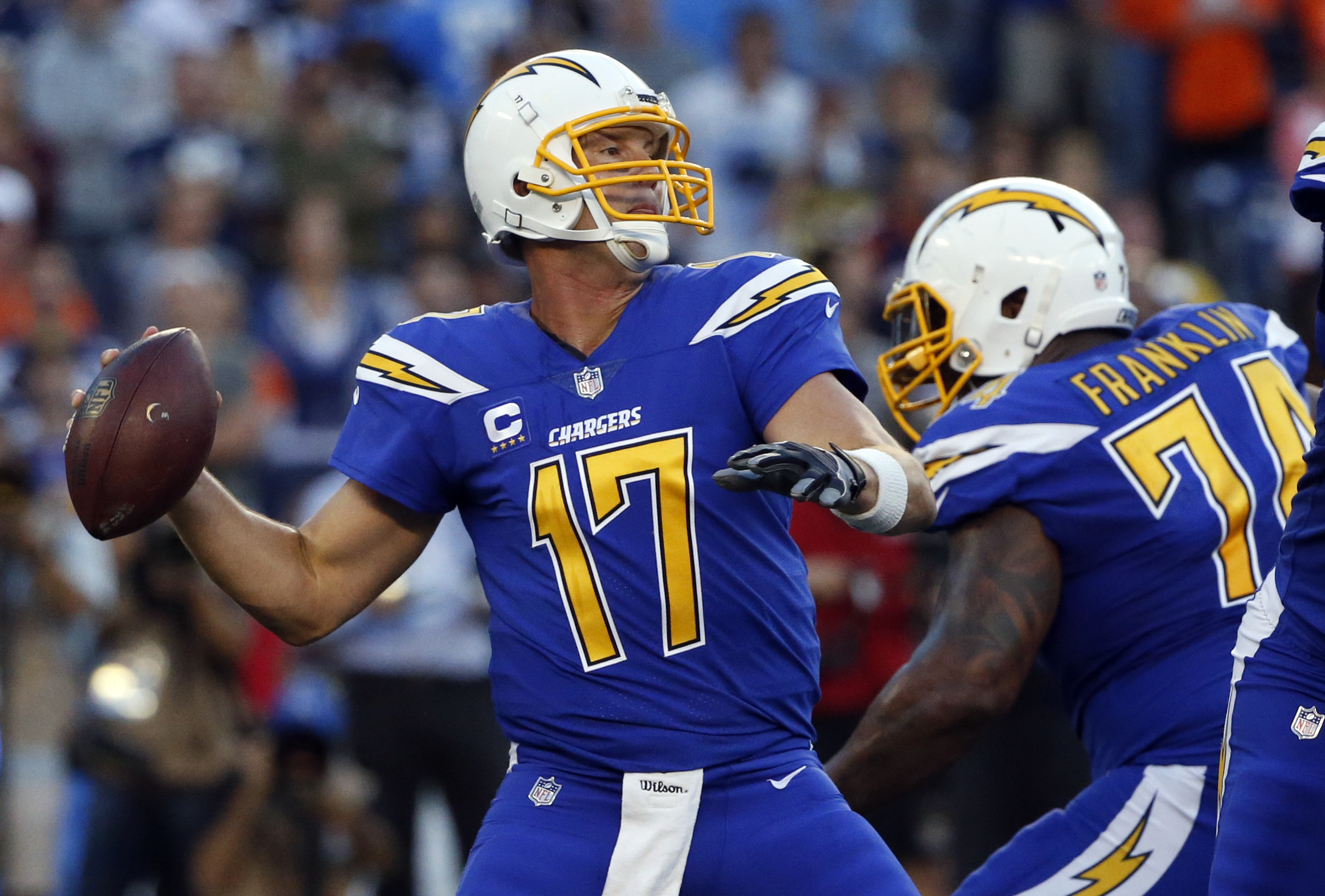 San Diego Chargers quarterback Philip Rivers throws a pass during the first half of an NFL football game against the Denver Broncos, Thursday, Oct. 13, 2016, in San Diego. (AP Photo/Lenny Ignelzi)