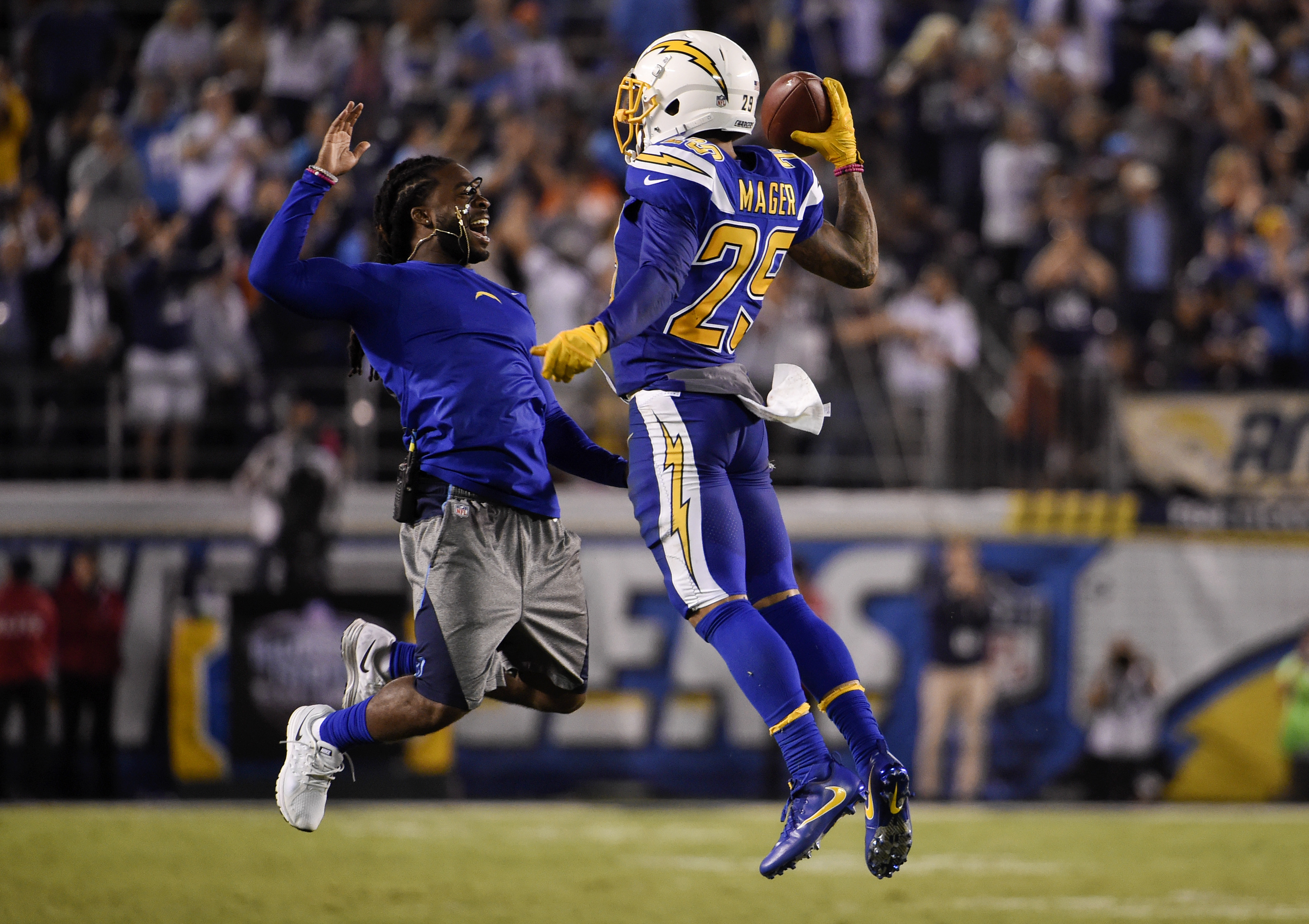 San Diego Chargers cornerback Craig Mager (29) reacts with teammate strong safety Jahleel Addae after picking up a fumble during the second half of an NFL football game against the Denver Broncos, Thursday, Oct. 13, 2016, in San Diego. (AP Photo/Denis Por