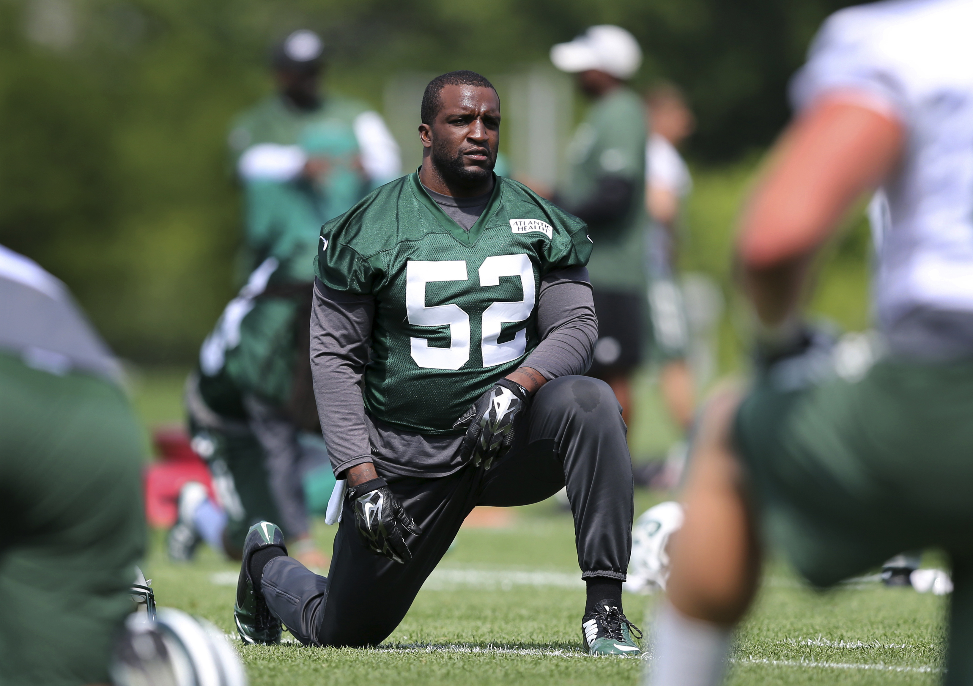 FILE - In this Wednesday, June 1, 2016, file photo, New York Jets linebacker David Harris (52) stretches during NFL football practice in Florham Park, N.J. Harris was listed Saturday, Oct. 15, as doubtful to play against the Arizona Cardinals on Monday ni