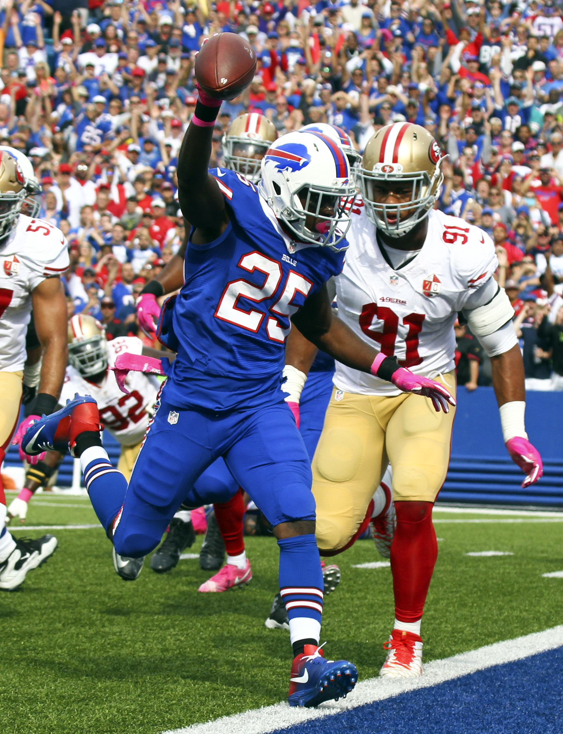 Buffalo Bills running back LeSean McCoy (25) scores a touchdown in front of San Francisco 49ers defensive end Arik Armstead (91) during the first half of an NFL football game on Sunday, Oct. 16, 2016, in Orchard Park, N.Y. (AP Photo/Jeffrey T. Barnes)