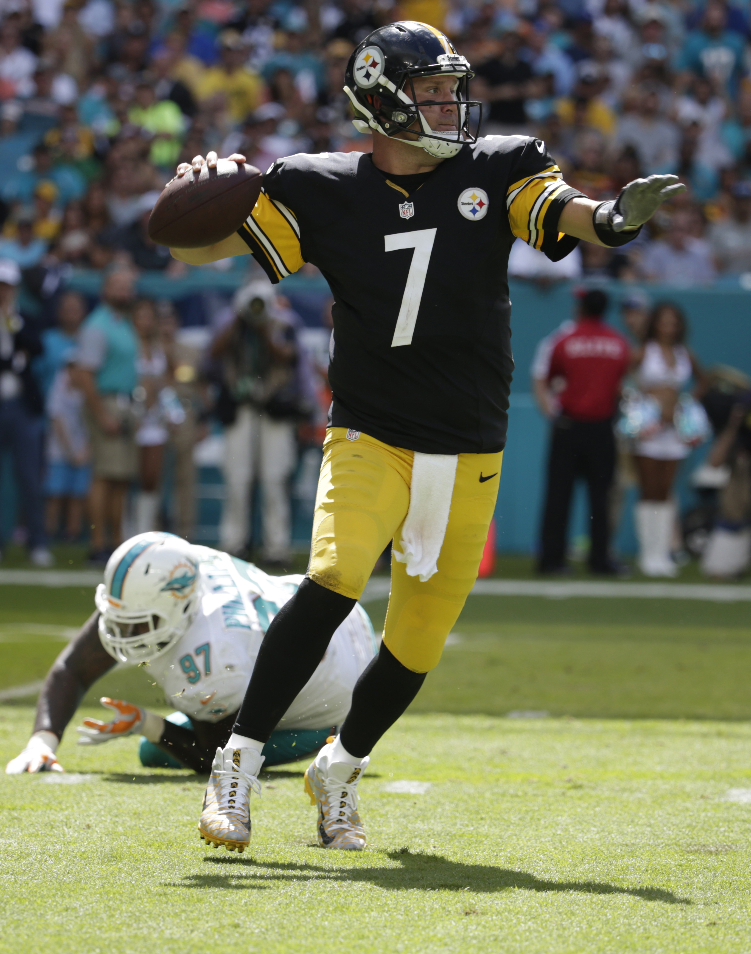 Pittsburgh Steelers quarterback Ben Roethlisberger (7) looks to pass after escaping a tackle by Miami Dolphins defensive tackle Jordan Phillips (97), during the first half of an NFL football game, Sunday, Oct. 16, 2016, in Miami Gardens, Fla. Roethlisberg