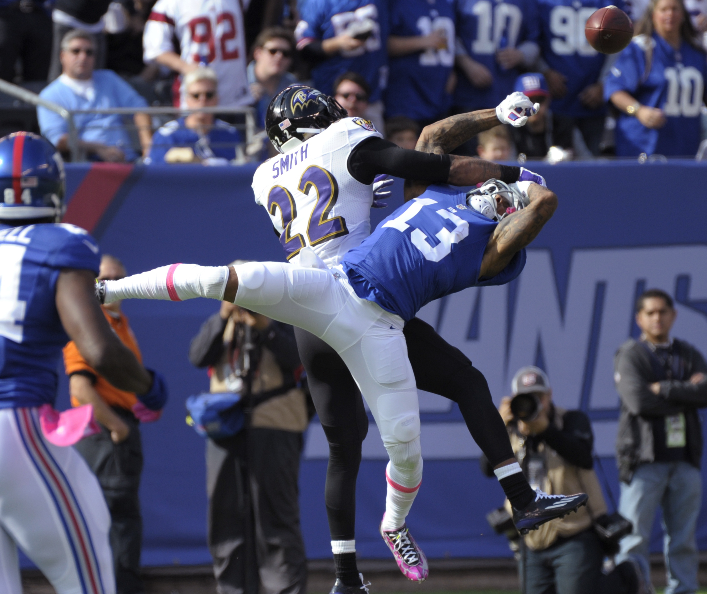 Baltimore Ravens cornerback Jimmy Smith (22) defends New York Giants' Odell Beckham (13) during the first half of an NFL football game, Sunday, Oct. 16, 2016, in East Rutherford, N.J. Beckham was hurt on the play. (AP Photo/Bill Kostroun)