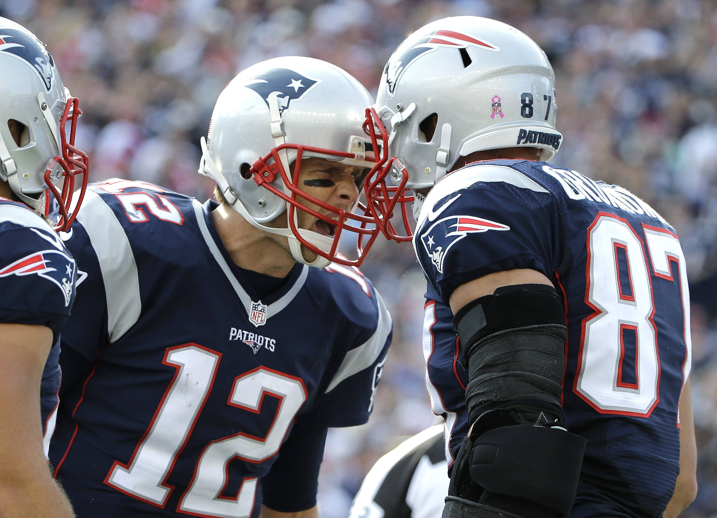 New England Patriots quarterback Tom Brady (12) celebrates his touchdown pass to tight end Rob Gronkowski (87) during the second half of an NFL football game against the Cincinnati Bengals, Sunday, Oct. 16, 2016, in Foxborough, Mass. (AP Photo/Elise Amend