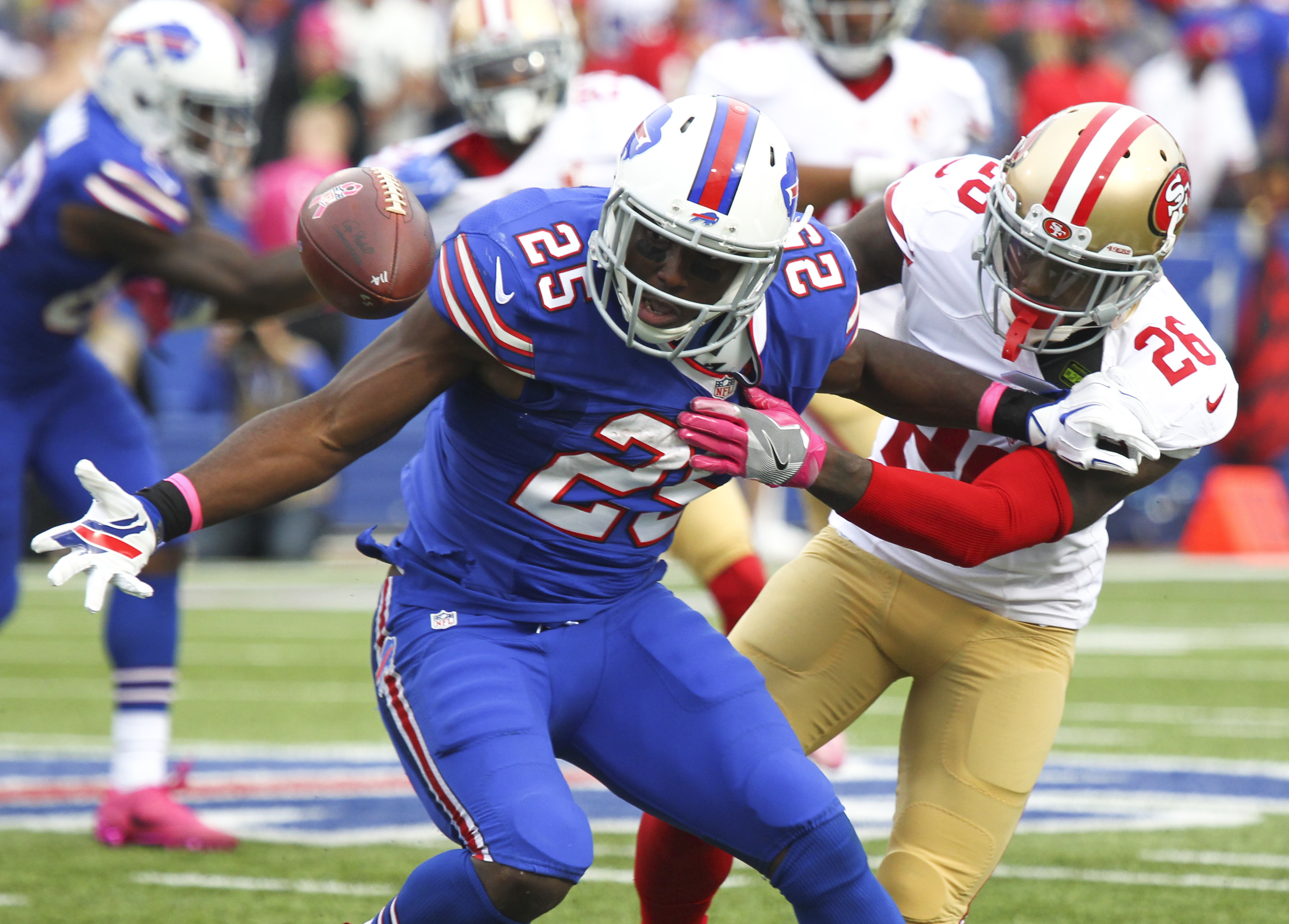Buffalo Bills running back LeSean McCoy (25) loses the ball momentarily as he is hit by San Francisco 49ers cornerback Tramaine Brock (26) during the second half of an NFL football game on Sunday, Oct. 16, 2016, in Orchard Park, N.Y. (AP Photo/Jeffrey T.