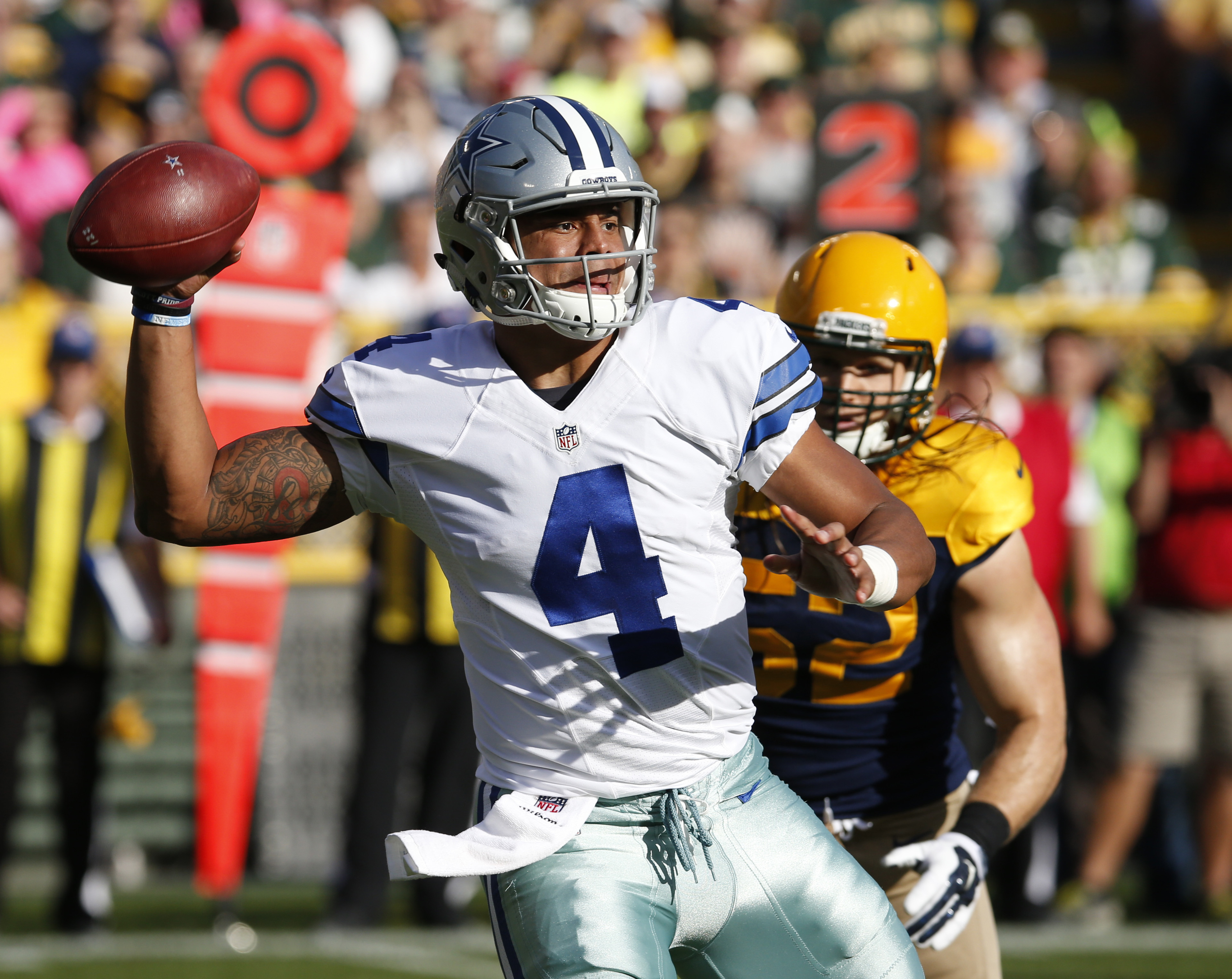 Dallas Cowboys' Dak Prescott throws during the first half of an NFL football game against the Green Bay Packers Sunday, Oct. 16, 2016, in Green Bay, Wis. (AP Photo/Mike Roemer)