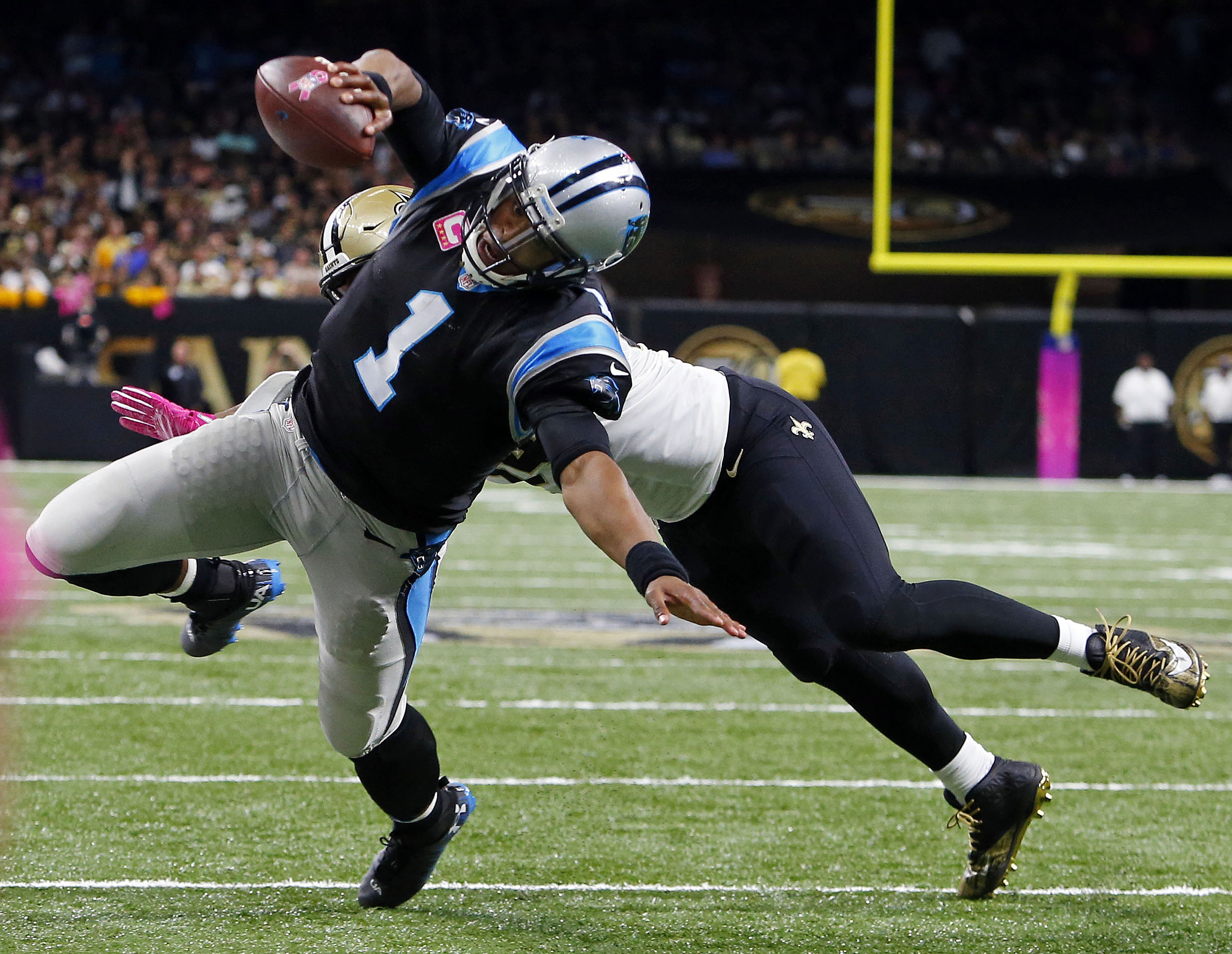 Carolina Panthers quarterback Cam Newton (1) dives for a touchdown in the second half of an NFL football game against the New Orleans Saints in New Orleans, Sunday, Oct. 16, 2016. (AP Photo/Butch Dill)