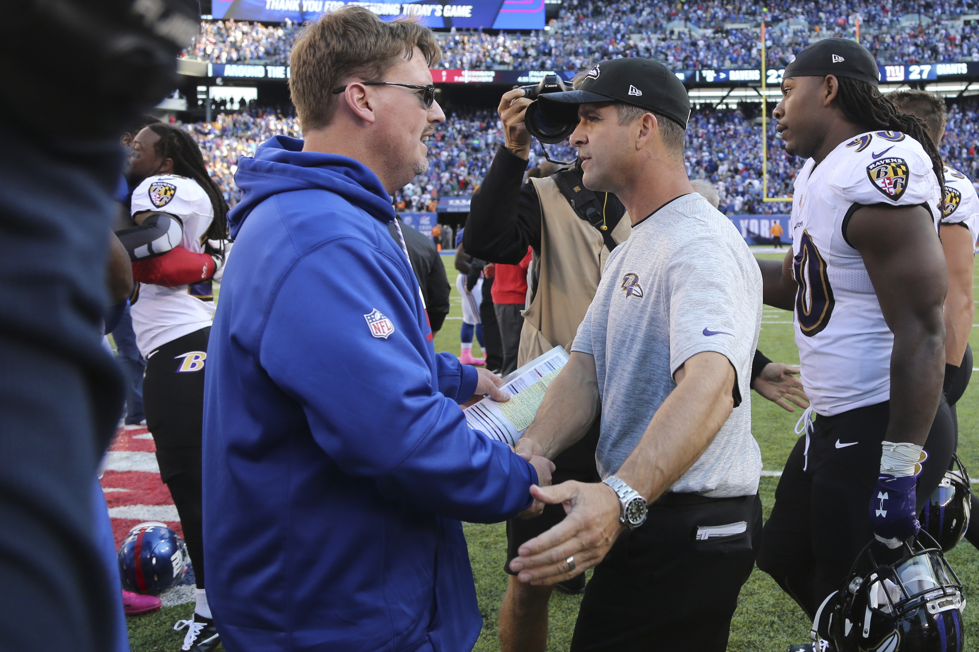 New York Giants head coach Ben McAdoo, left, shakes hands with Baltimore Ravens head coach John Harbaugh, right, after an NFL football game Sunday, Oct. 16, 2016, in East Rutherford, N.J. The Giants won 27-23. (AP Photo/Seth Wenig)