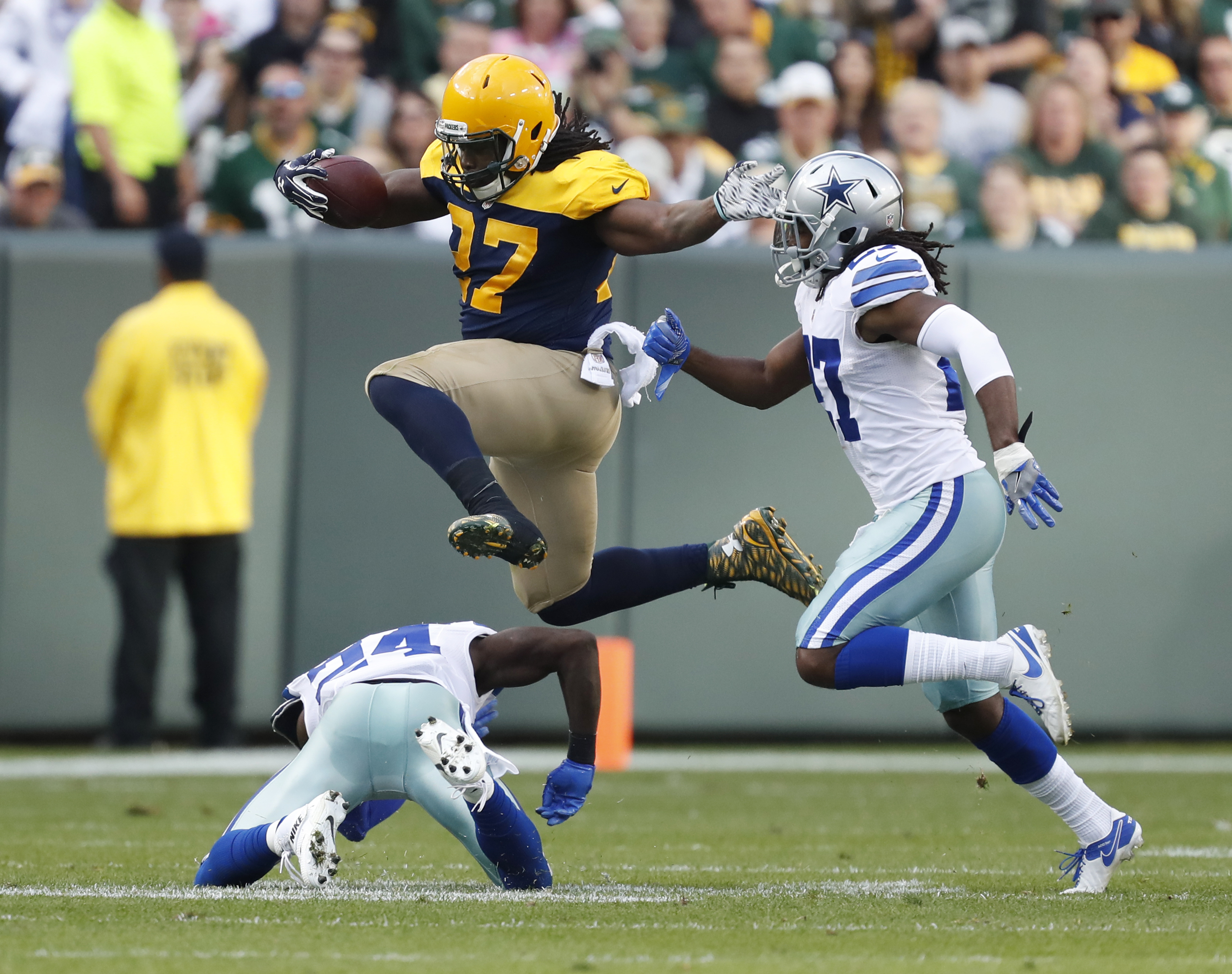 Green Bay Packers' Eddie Lacy leaps over Dallas Cowboys' Morris Claiborne during the first half of an NFL football game Sunday, Oct. 16, 2016, in Green Bay, Wis. (AP Photo/Matt Ludtke)
