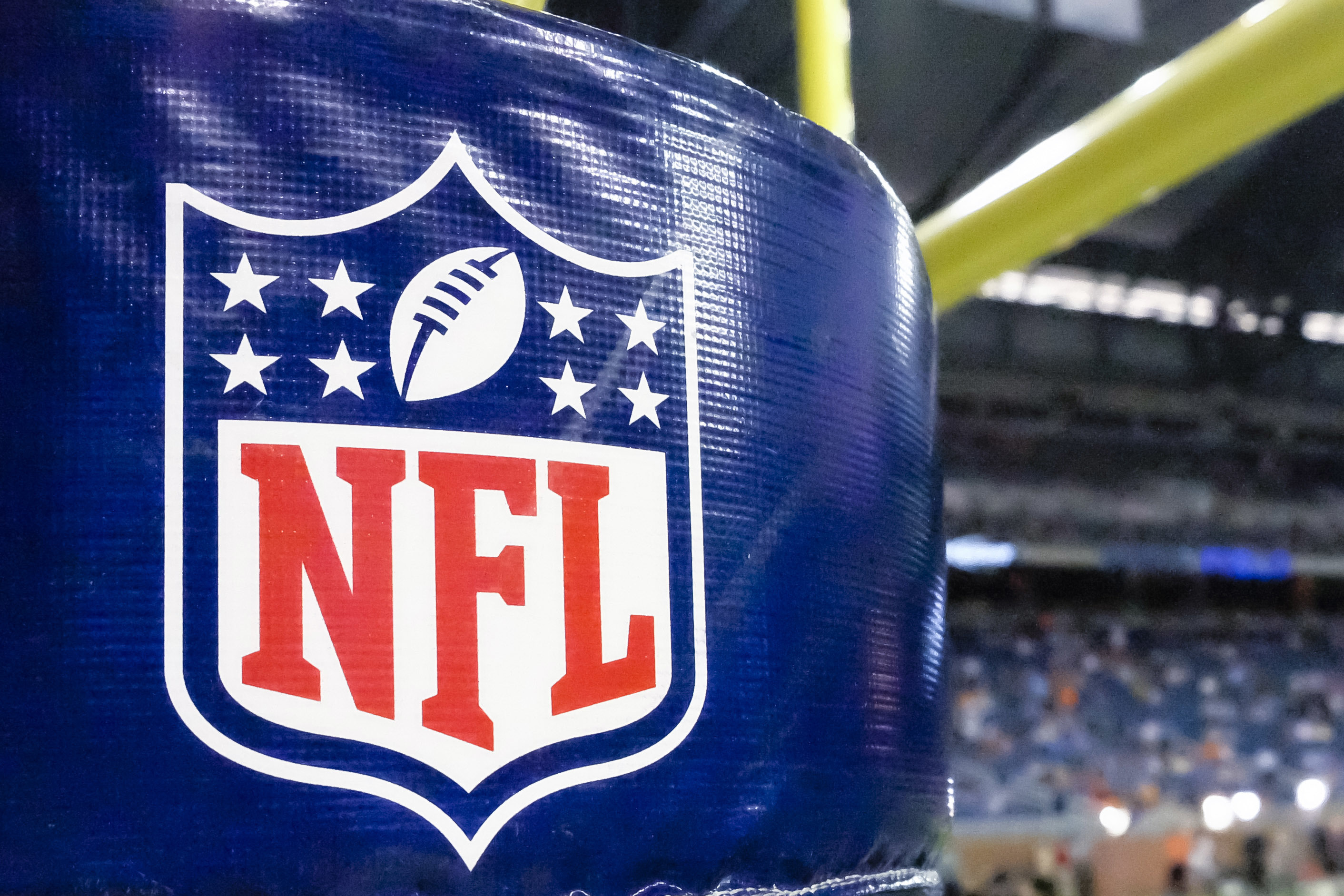 FILE - This Aug. 9, 2014 file photo shows an NFL logo on a goal post padding before a preseason NFL football game between the Detroit Lions and the Cleveland Browns at Ford Field in Detroit. Sports Illustrated reported in October 2016 that the NFL is stri
