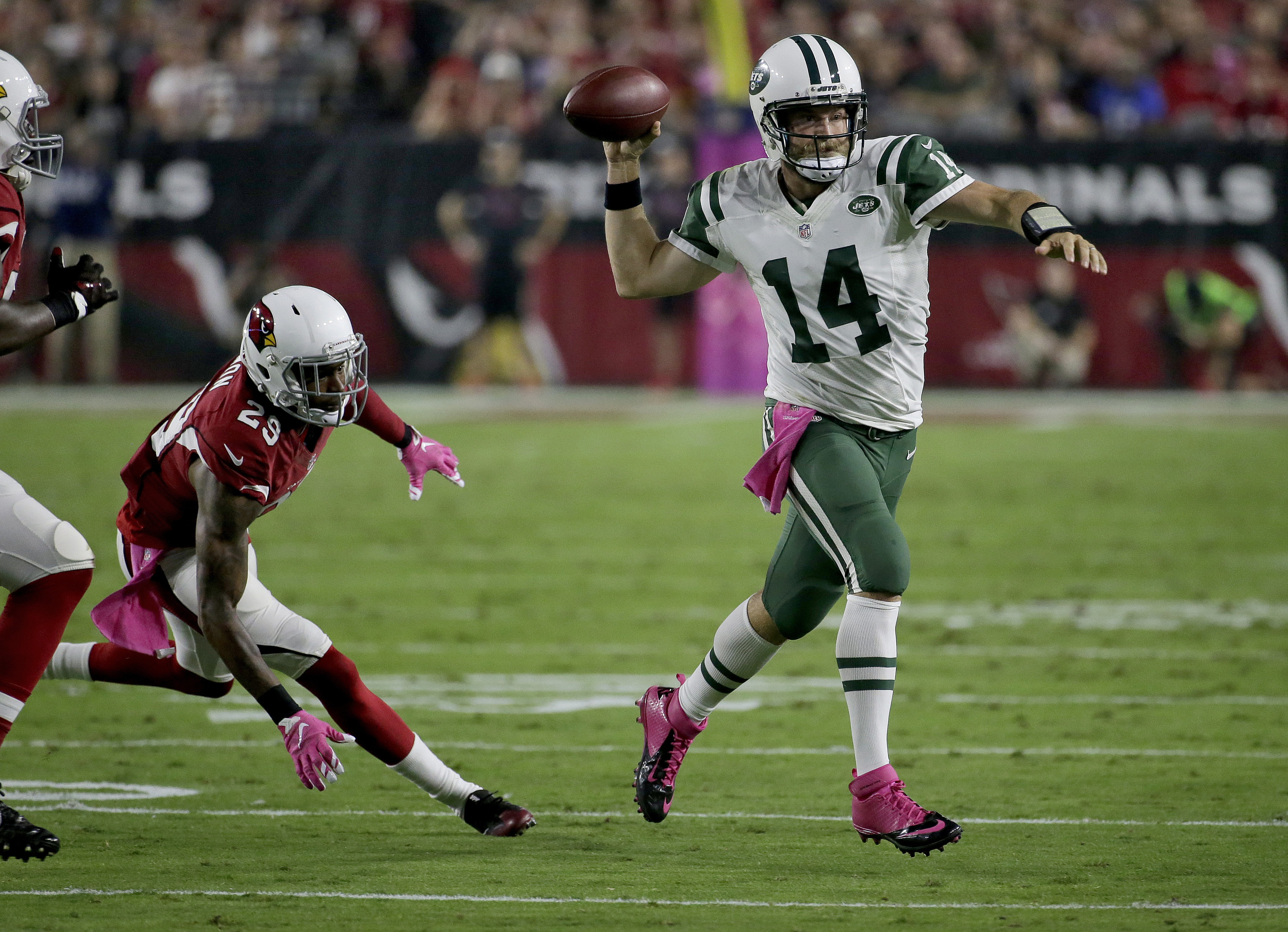 New York Jets quarterback Ryan Fitzpatrick (14) throws as Arizona Cardinals cornerback Tharold Simon (29) pursues during the first half of an NFL football game, Monday, Oct. 17, 2016, in Glendale, Ariz. (AP Photo/Rick Scuteri)